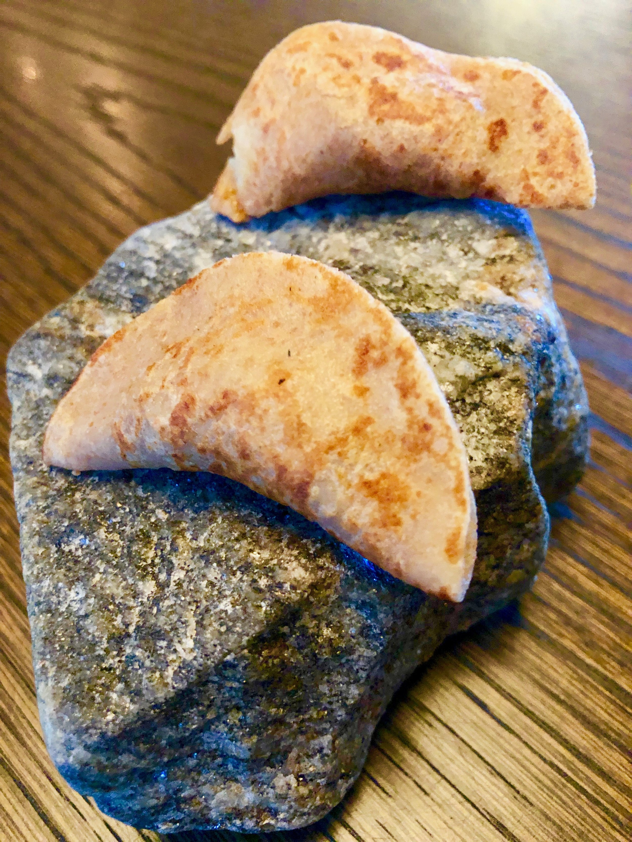 Amuse-bouche 4 – Pancake of emmer (a Eurasian wheat) with fermented plum, grilled pork and lardo from Svartskog Gard