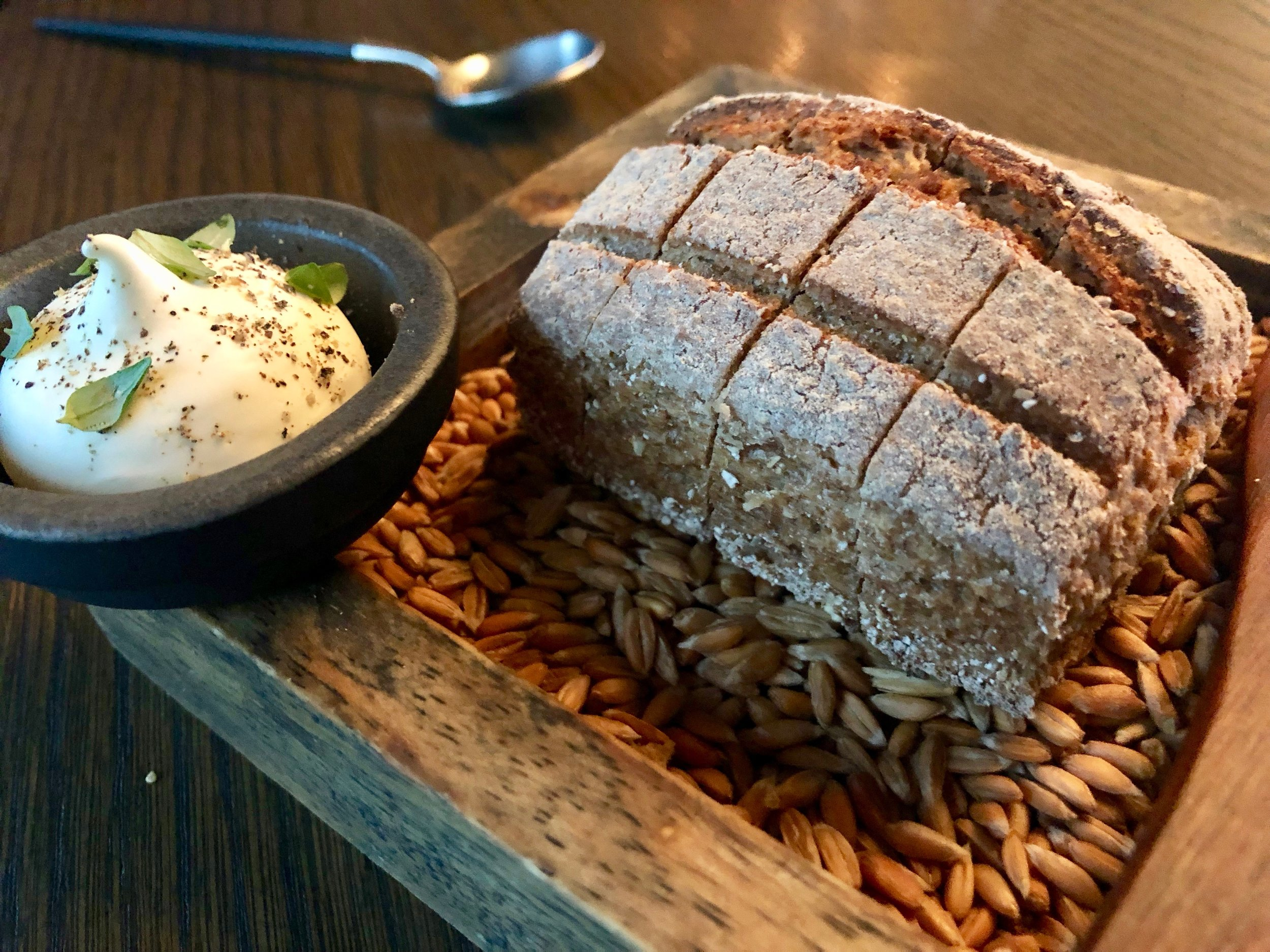 """In case all those courses aren't enough, Kontrast also brings each diner an individual sliced sourdough rye bread. It's served with organic butter blended with pork fat, rosemary and thyme. So much for my colleague saying, """"It isn't a heavy dinner. It's a fishy dinner."""" #worthit"""