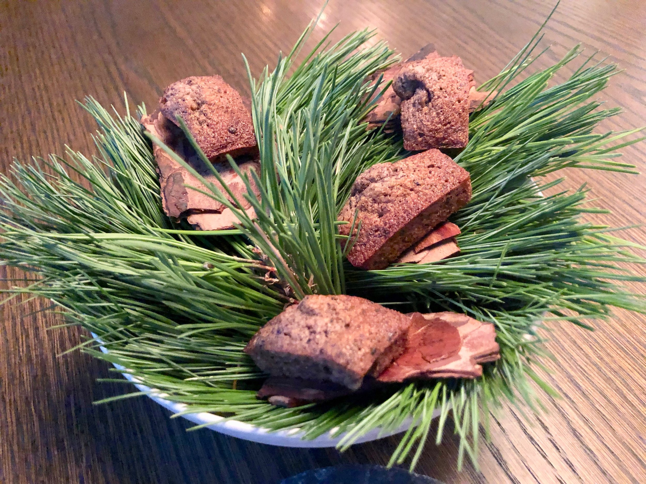 In addition to two sweet sugar-coated cherry jelly candies, our meal ended with a surprise plate of miniature cakes made with grounded pine bark blended into a cake mix and baked. The flavor was wondrous, woodsy and herbal while mildly sweet. Astounding. Just astounding.