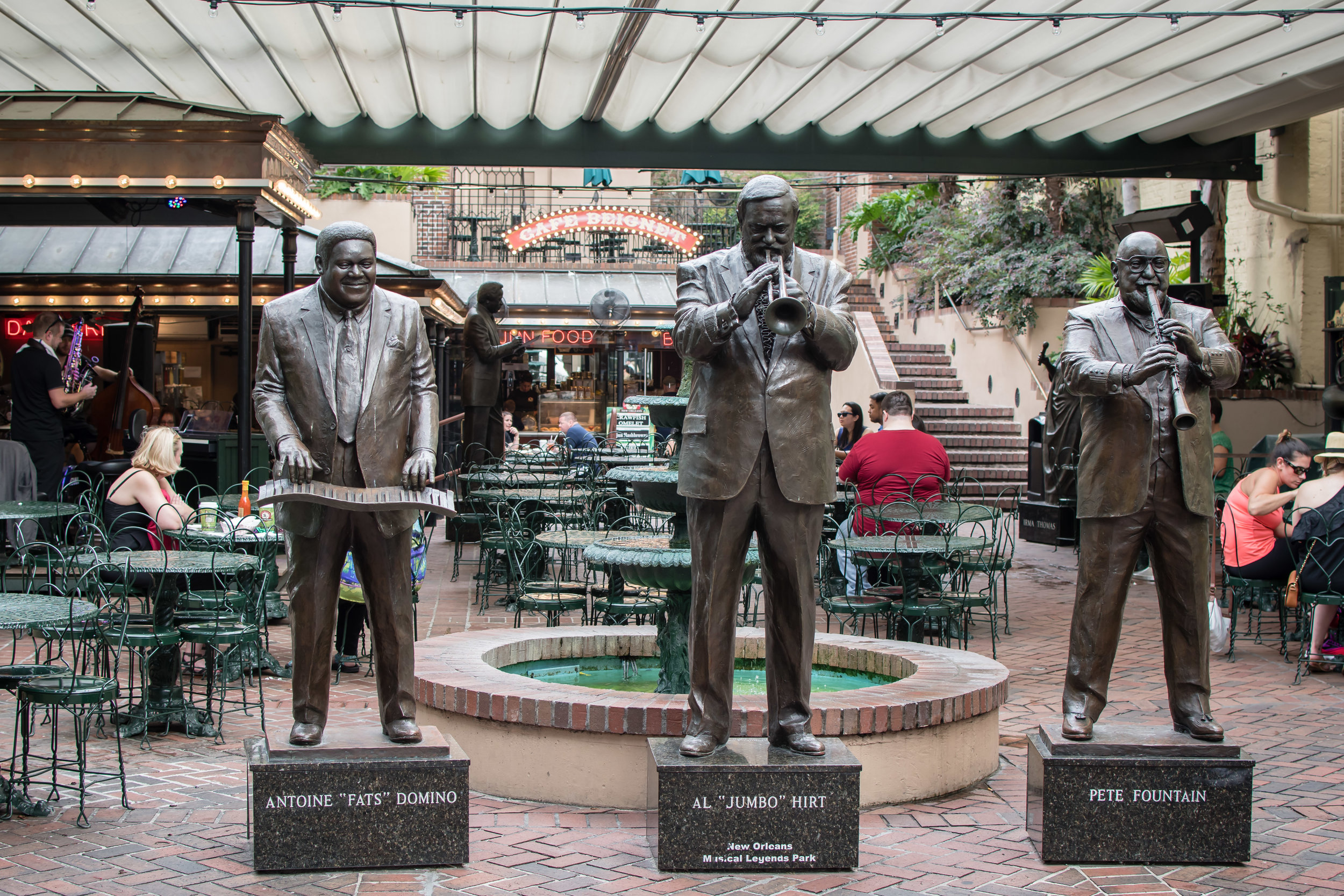 Statues of Jazz Musicians near the entrance of Cafe Beignet in Bourbon Street.