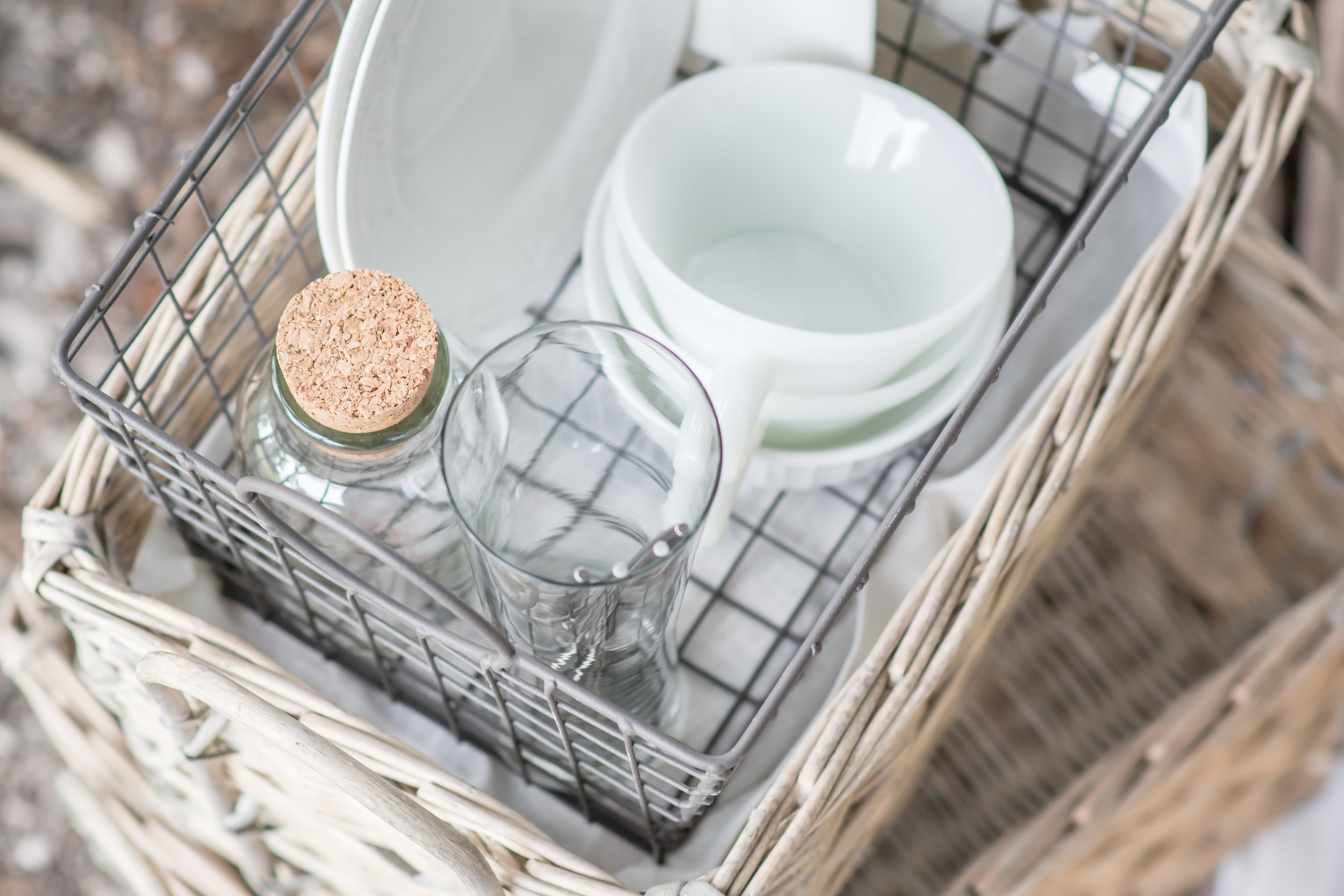 white dishes on wood baskets