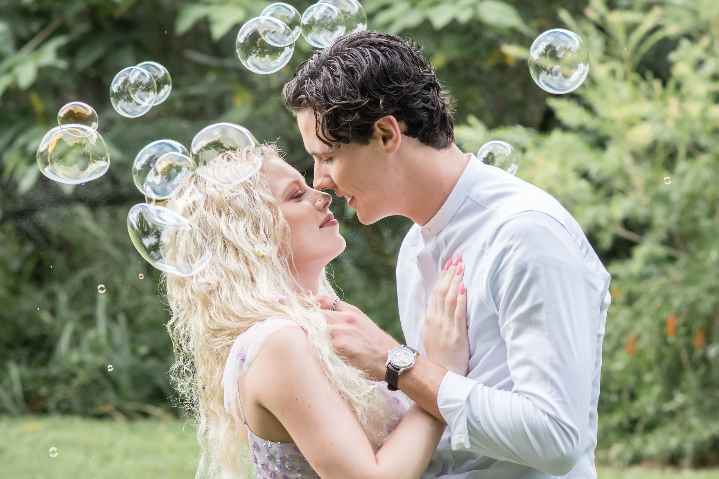 couple kissing with bubbles