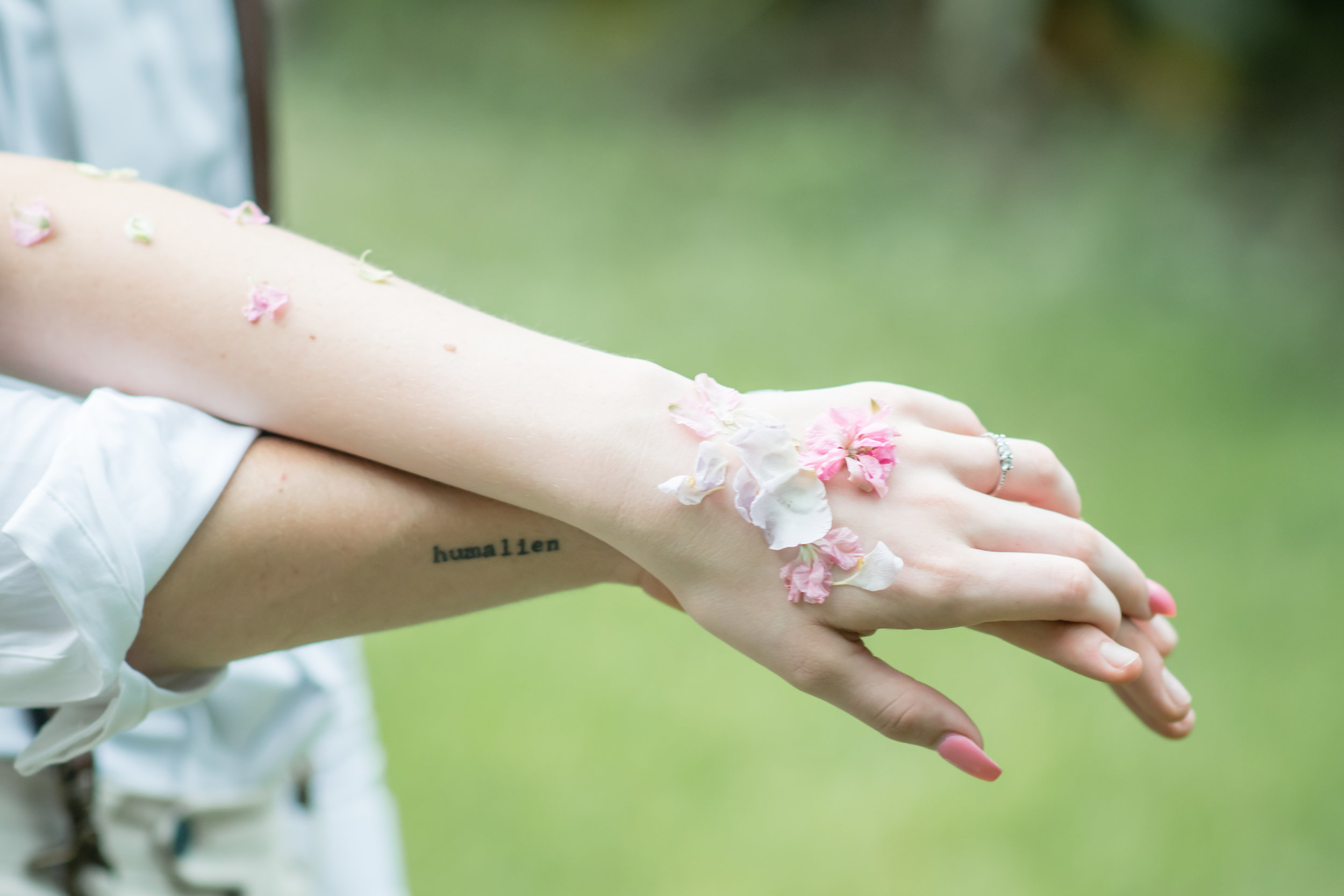 close up images of bride and groom with florals on skin