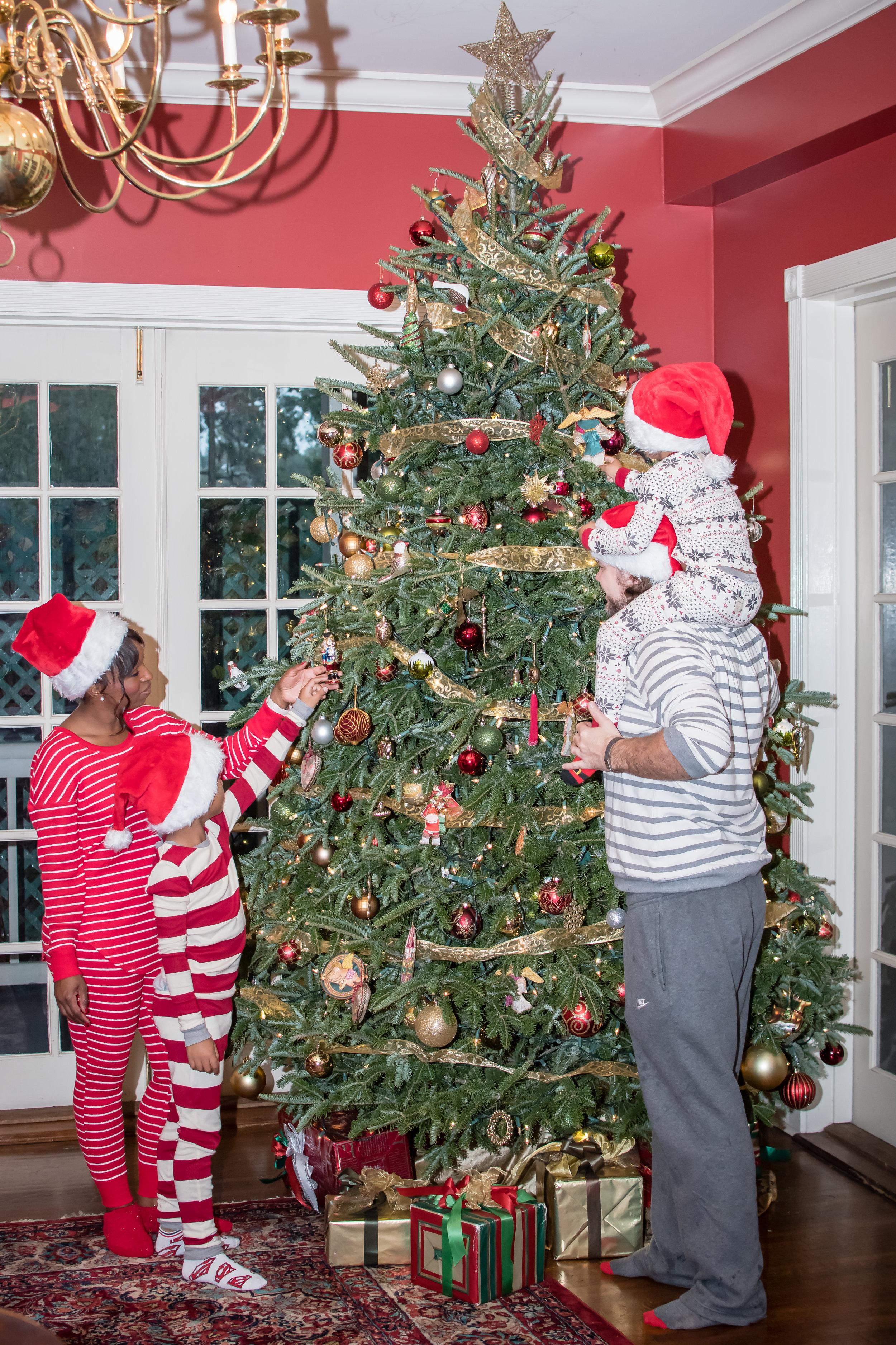 Christmas Day in pajamas photos by the tree Orlando Photographer Yanitza Ninett