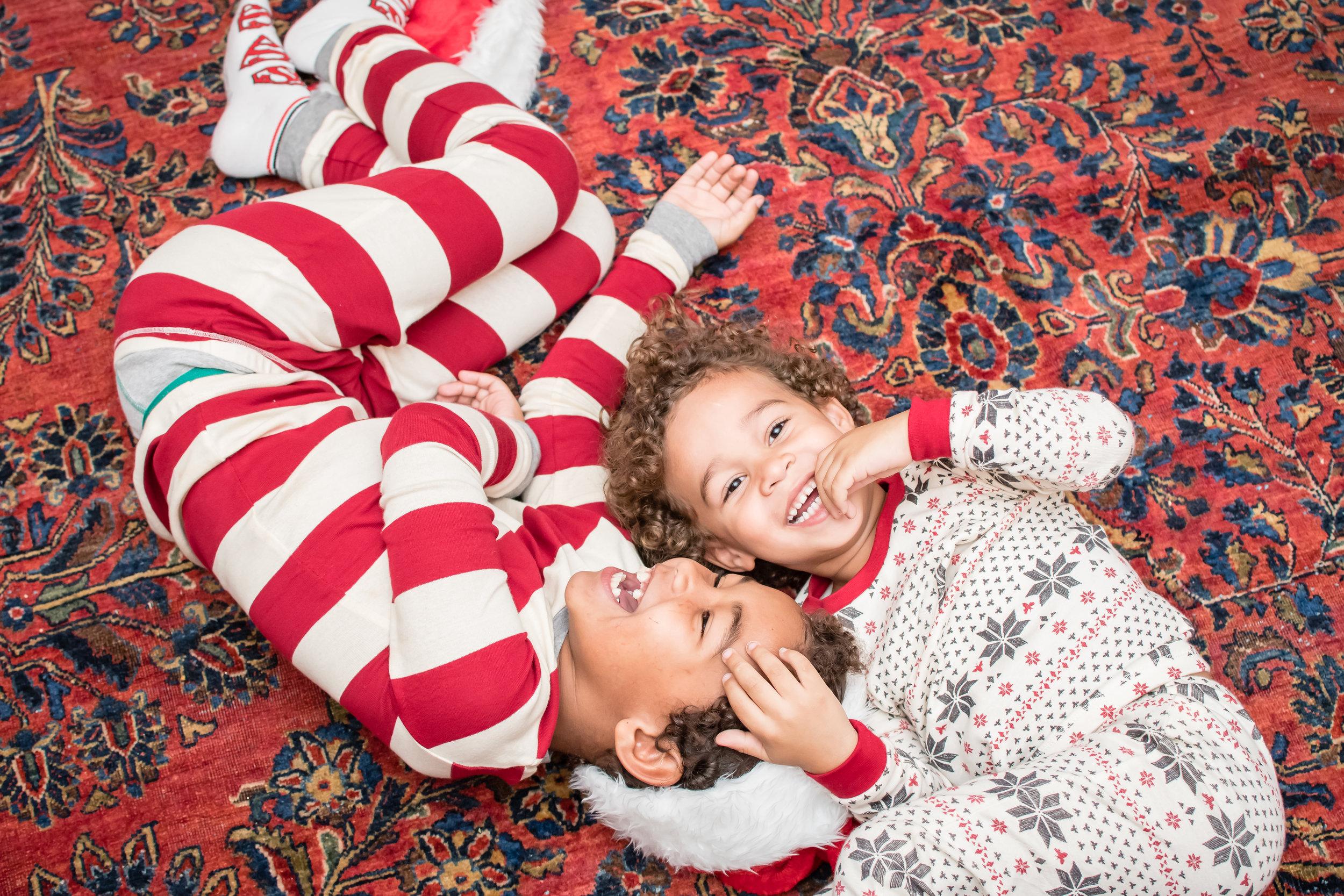 photos laying down Christmas Day pajamas Orlando Photographer Yanitza Ninett