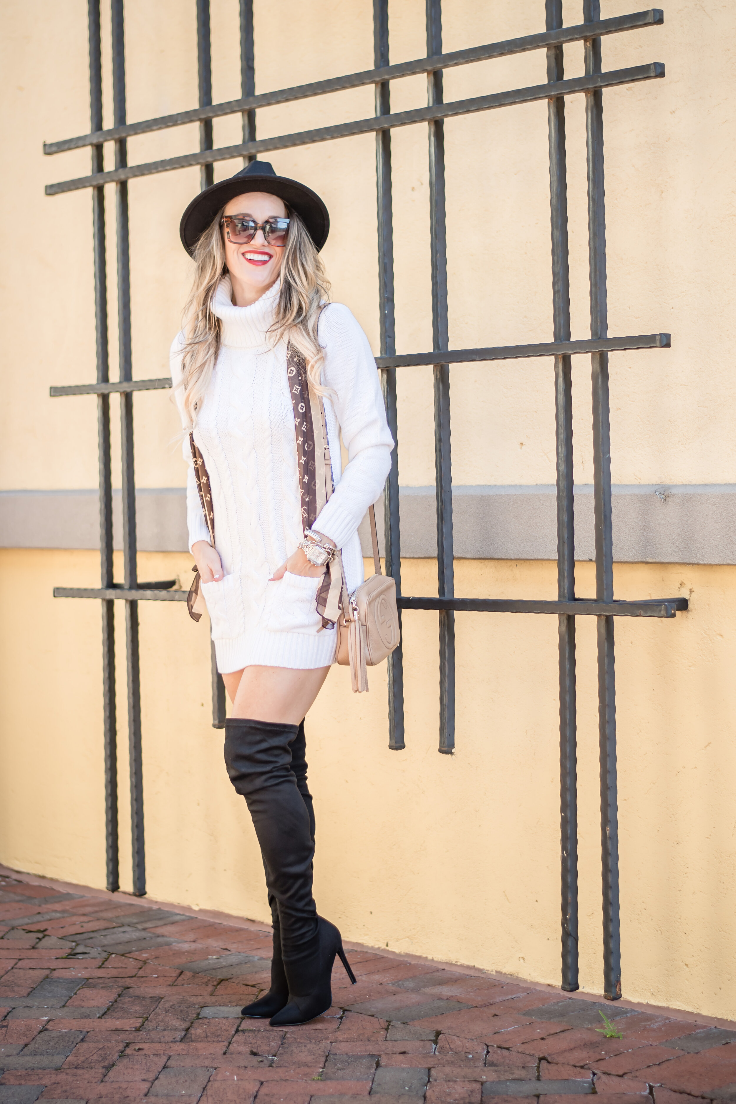 white sweater dress with black boots