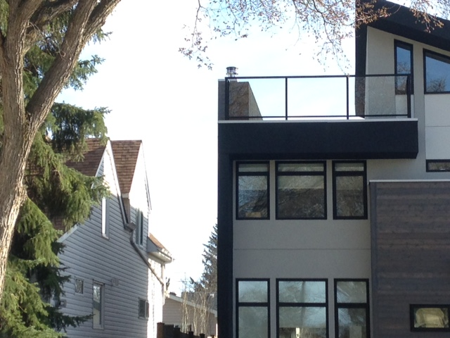 Front, Side, Back platform on second story looking into bedroom windows and bathroom skylight of neighbour.JPG
