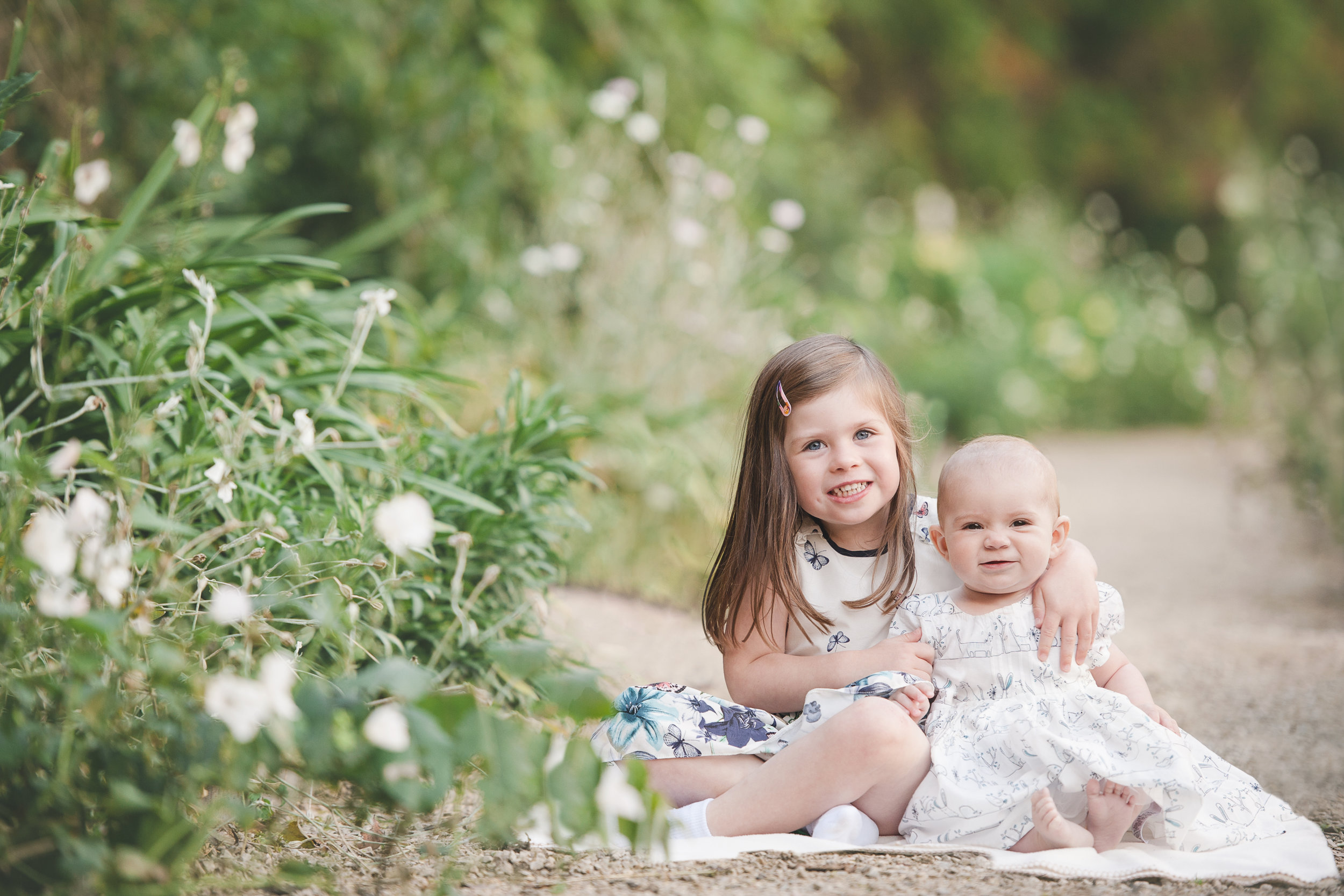 family photography cheshire showing siblings in spring outdoor photo shoot