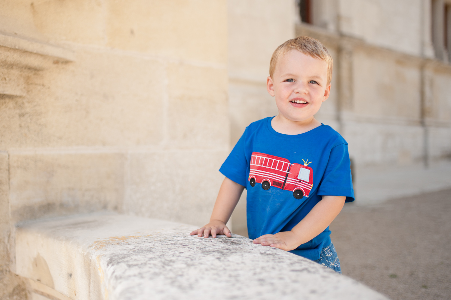 On a super-sunny day, I took my son to the shady side of the castle for a better photo