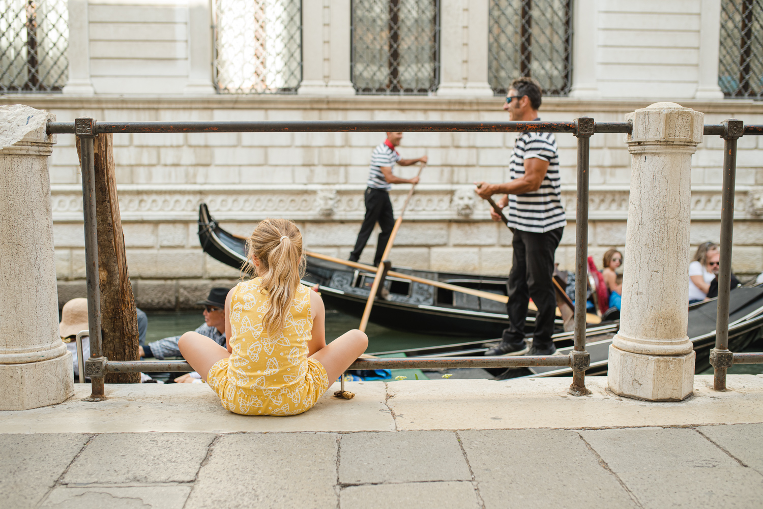 Deep in thought watching tourists and gondoliers