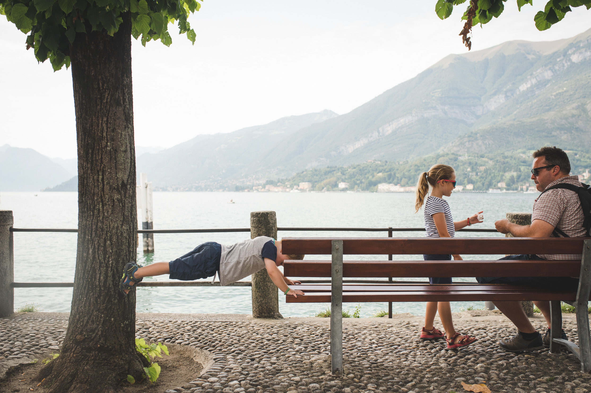 My son doing some impromptu yoga at Lake Como in Italy
