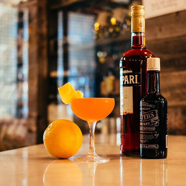 """Here's a new drink from our summer menu! """"Get It Twisted"""" uses American vodka, Campari, mango syrup, and Australian aromatic bitters to make a refreshing summer cocktail. . . . . #cocktails #beer #wine #craft #allnatural #seasonal #happyhour #datenight #oc #tustin #irvine #drinklocal #centralbaroc #humpday"""