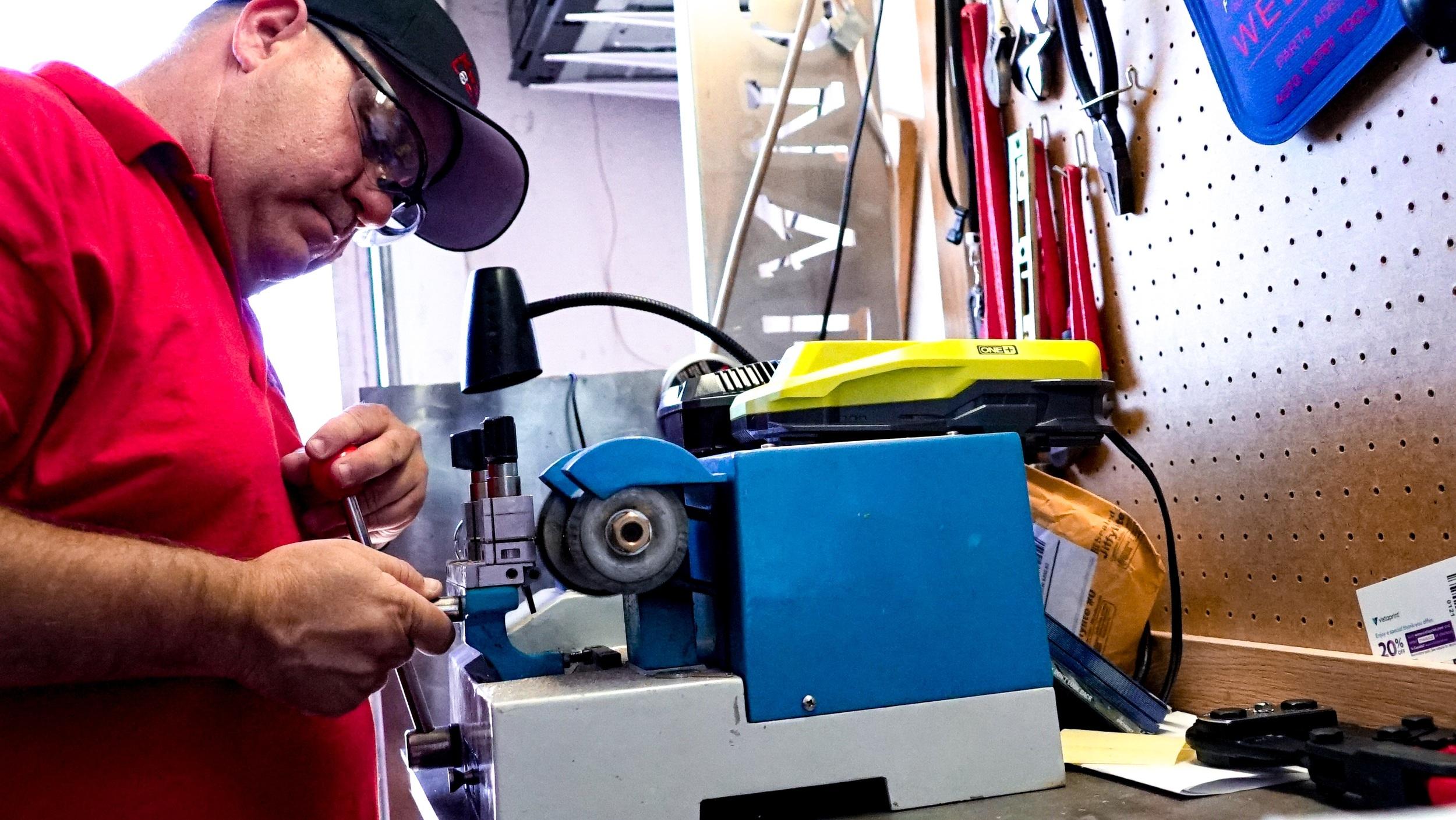 Bill working on a re-key job
