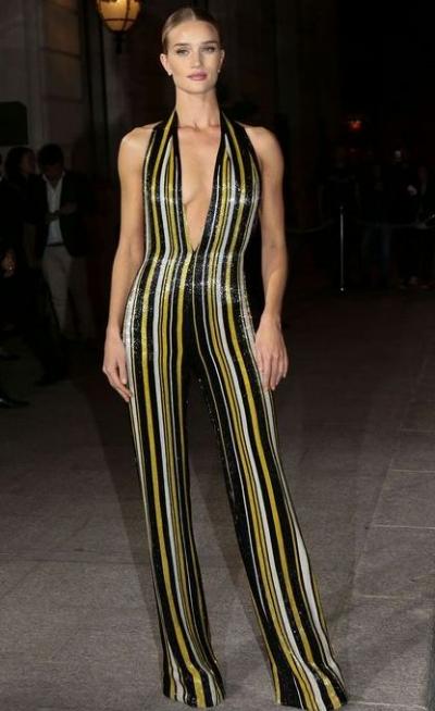 http://fashionbombdaily.com/hot-hmmm-rosie-huntington-whiteley-balmain-striped-halter-jumpsuit/