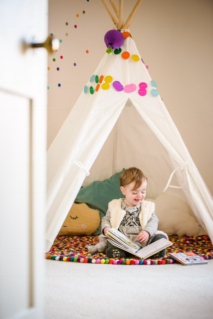 My beautiful Goddaughter having a lovely time with books in her reading den!