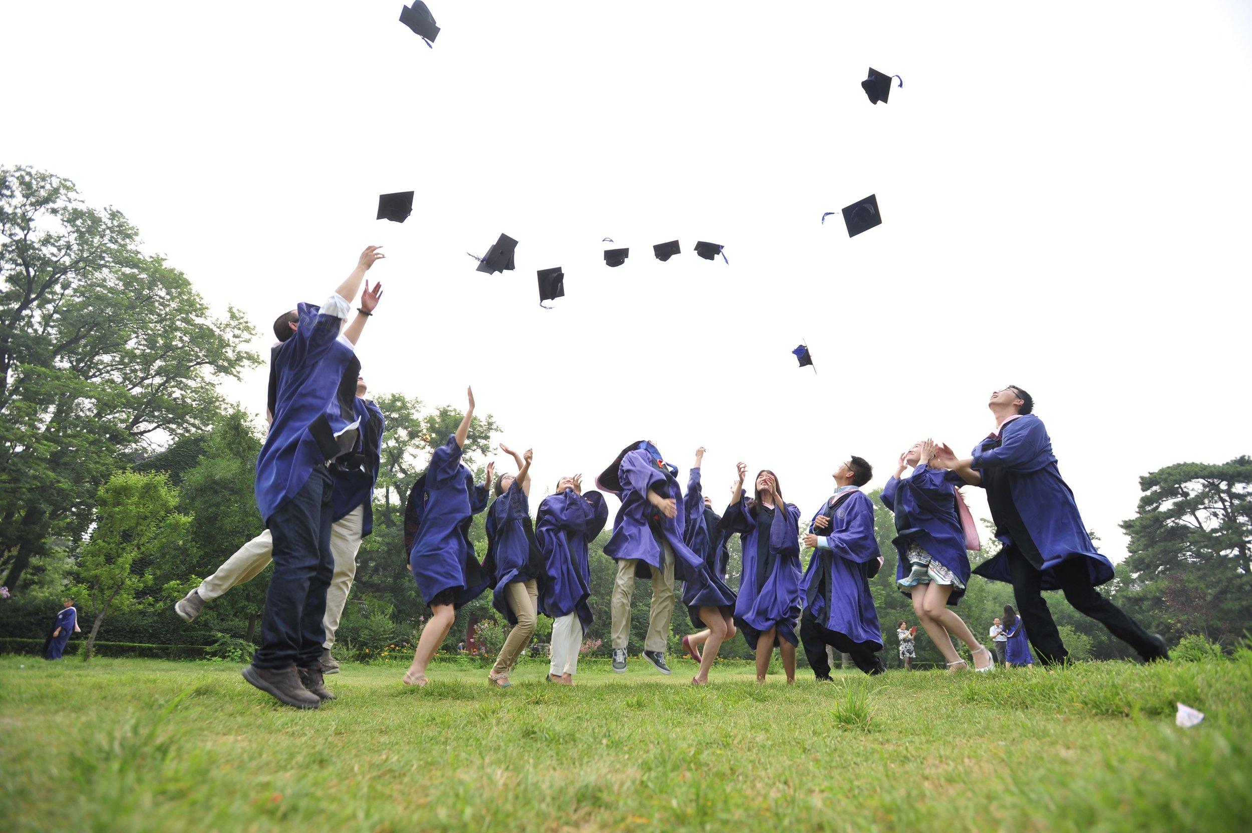 people-jumping-graduation-hats-dr-750137-pxhere.com.jpg