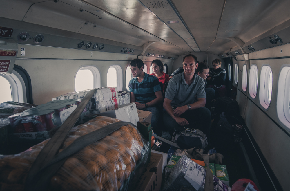 Researchers inside the small cargo plane. Greenland 2017