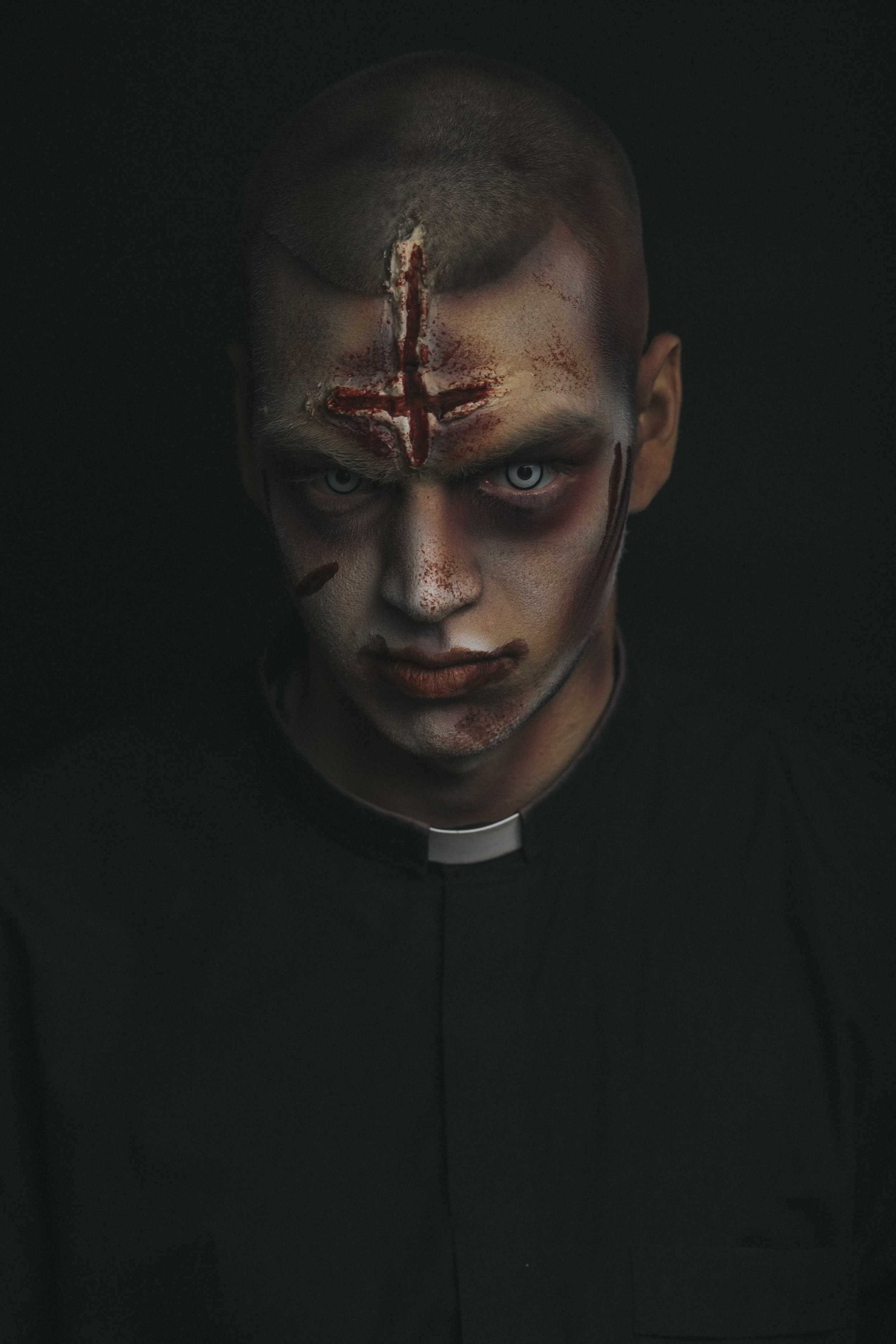 when I started at the Devil's Attic back in 2013 I wan't even in the makeup room. I was a midseason replacement for the priest character. With that said it's always been near and dear to me. when i started in the makeup room in 2014 not only was I not good at airbrush but I hated using it. With that said doing airbrush makeup on myself (something I do a lot now) was out of the question. Even last season I was still using grease paint on the priest. This year I upgraded the makeup room to all European Body Art alcohol based products and upgraded all of the makeups as well. I am very happy with how all of our monsters look and now our priest looks just as possessed as our Regan.