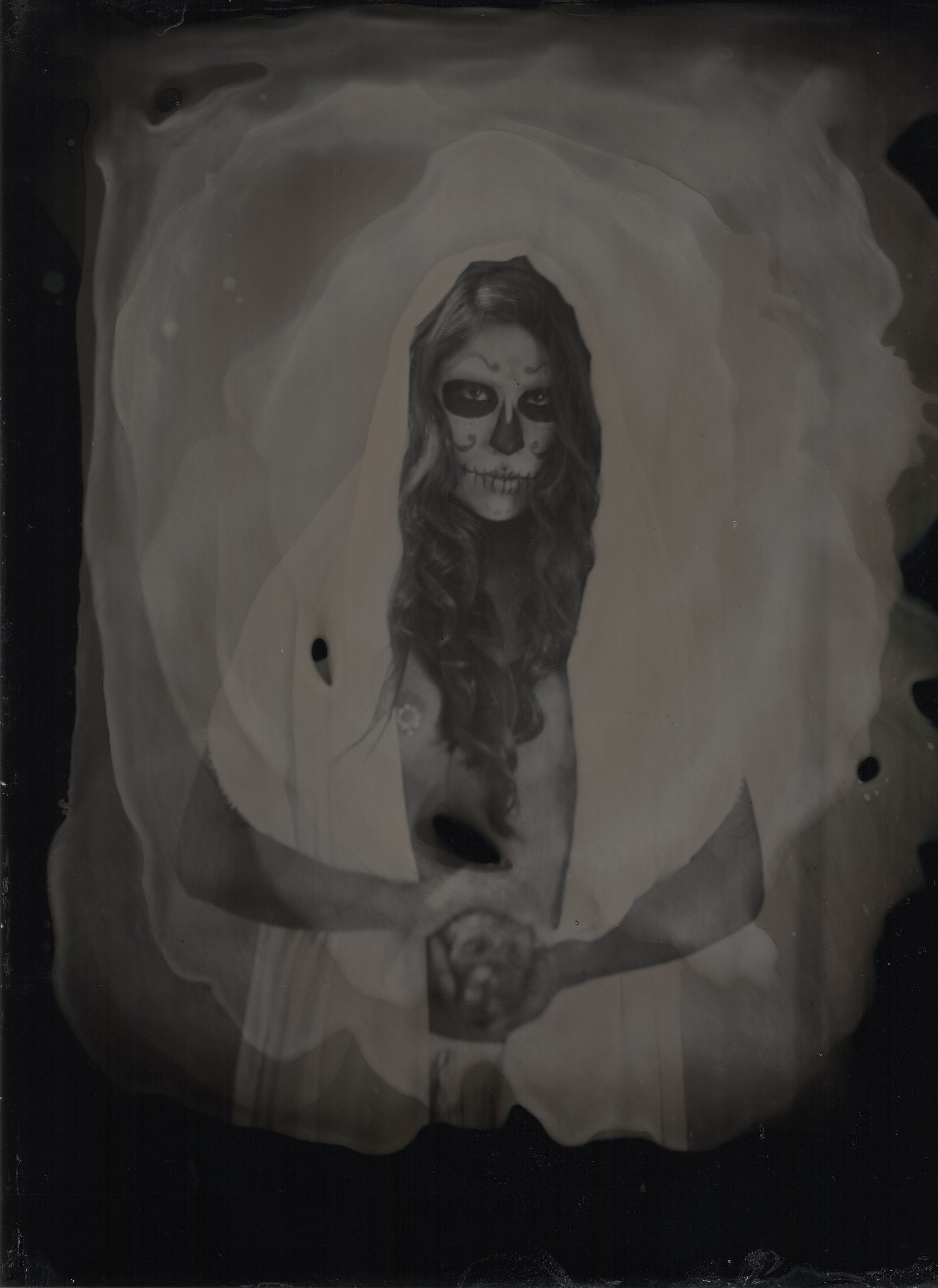 When talking to Photographer Dana Rogers about doing a tintype photo shoot with makeup I knew I wanted to do something fitting with the look and style that would fit. I wanted to do something timeless, something that looked like it existed when the camera was made back in the 1870's. It didn't take us long to land on Dia De Los Muertos or Day of the Dead.  I knew straight away that I wanted to use a Mexican model to keep things as authentic as possible. With my good friend and model Casandre Elyse Medel coming in town from Colorado we had one day to get it right. The weather was perfect and watching Dana work was like magic. Tintype photography is such an interesting and beautiful process. This image are scans of the original because the original is one of a kind.  I did this really pretty DOTD makeup with a color pallet I loved using lime greens, yellow, greys, black and white knowing it would be lost in black and white. At first I was a bit disappointed that no one would see that pallet but after I saw the first image processed I could not have been happier. It was like taking a trip in a time machine. I hope you enjoy.