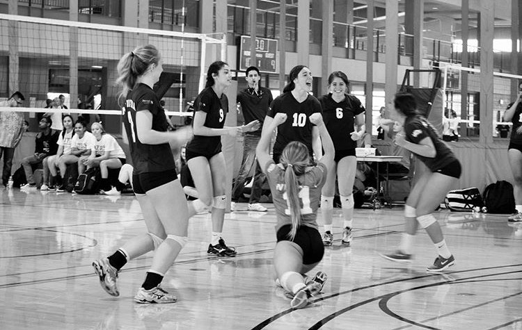 Tiffany (#10) celebrates with her teammates during a tournament with the University of Nevada Reno club team