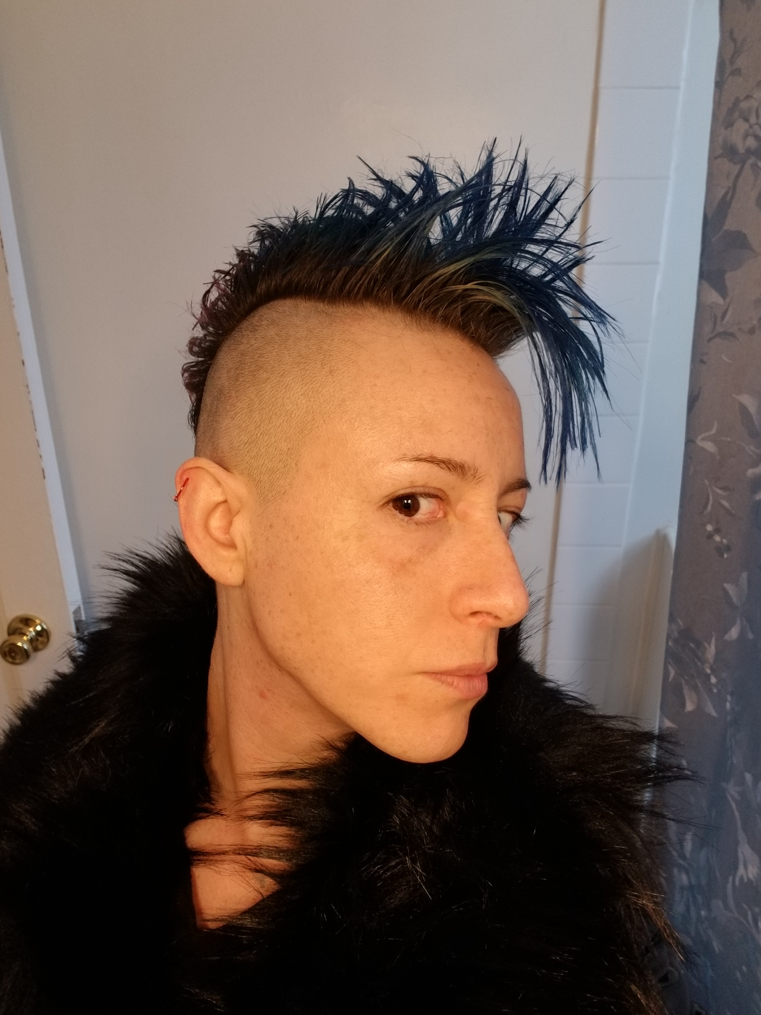 Emma Stewart - Emma Stewart (he/ they/ she) is a nonbinary trans poet. They are a first year poetry MFA candidate who writes about family and being queer.