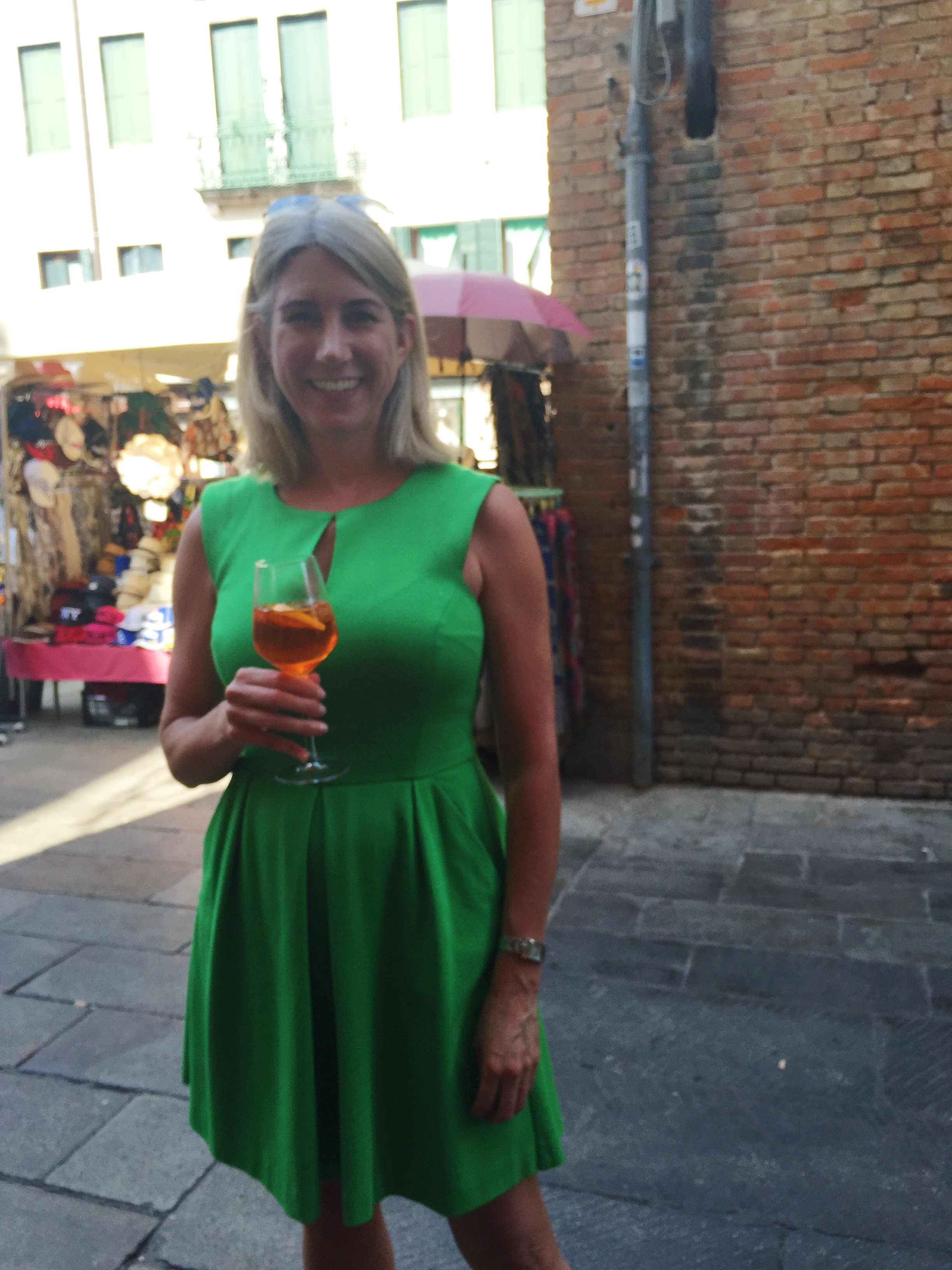 Sipping the ubiquitous Aperol Spritz in the Rialto Market in Venice, Italy, on a cooking trip with   Stirred Travel   — 2015