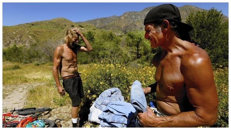 Dave Curry, right, visits his friend Russell Badgwell in Tujunga Wash, the place he used to call home. Curry received a Section 8 voucher from LA Family Housing and now lives in an apartment. (Francine Orr / Los Angeles Times)