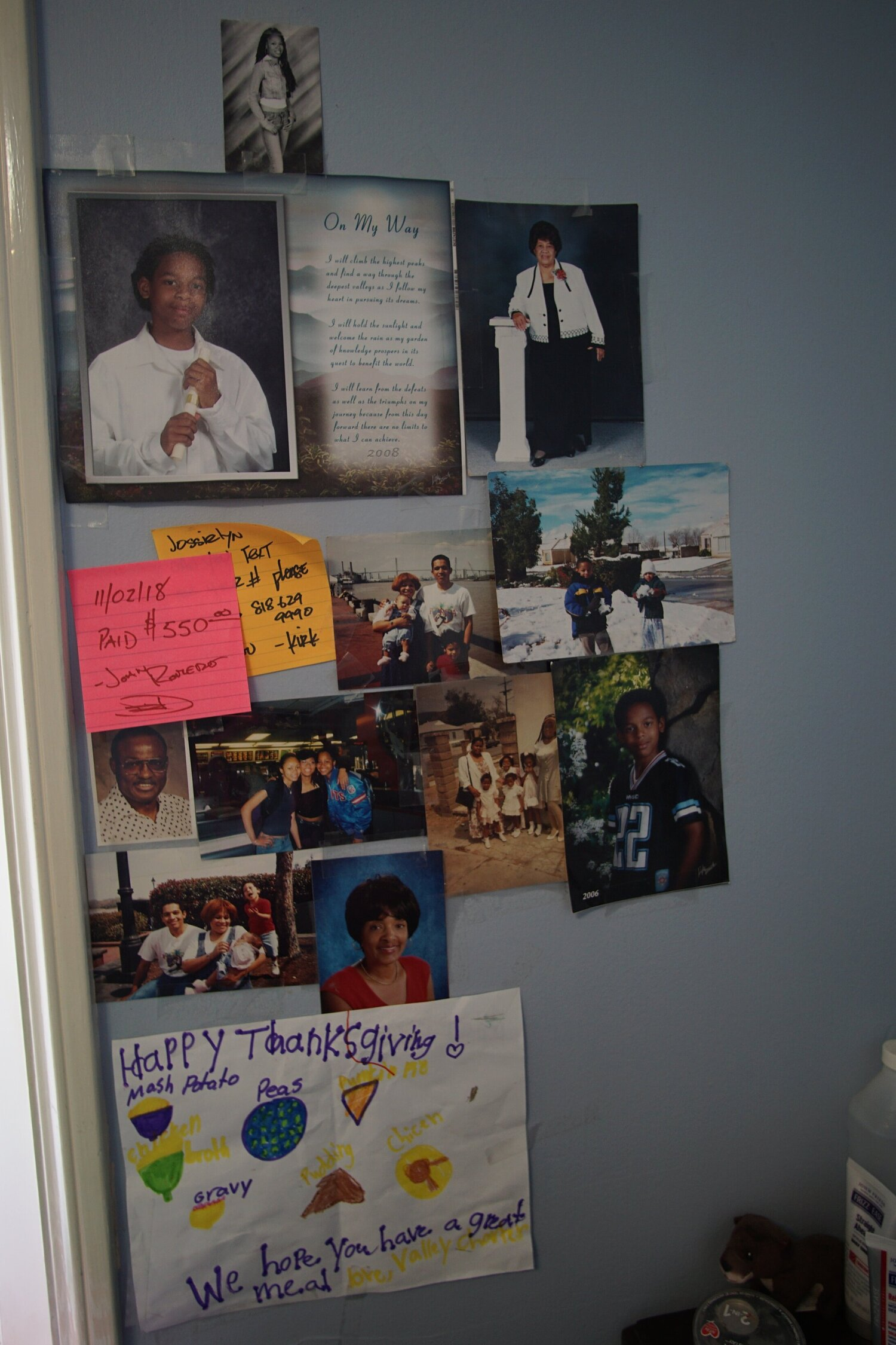 Images of Jessie's family are posted on the wall of her room.
