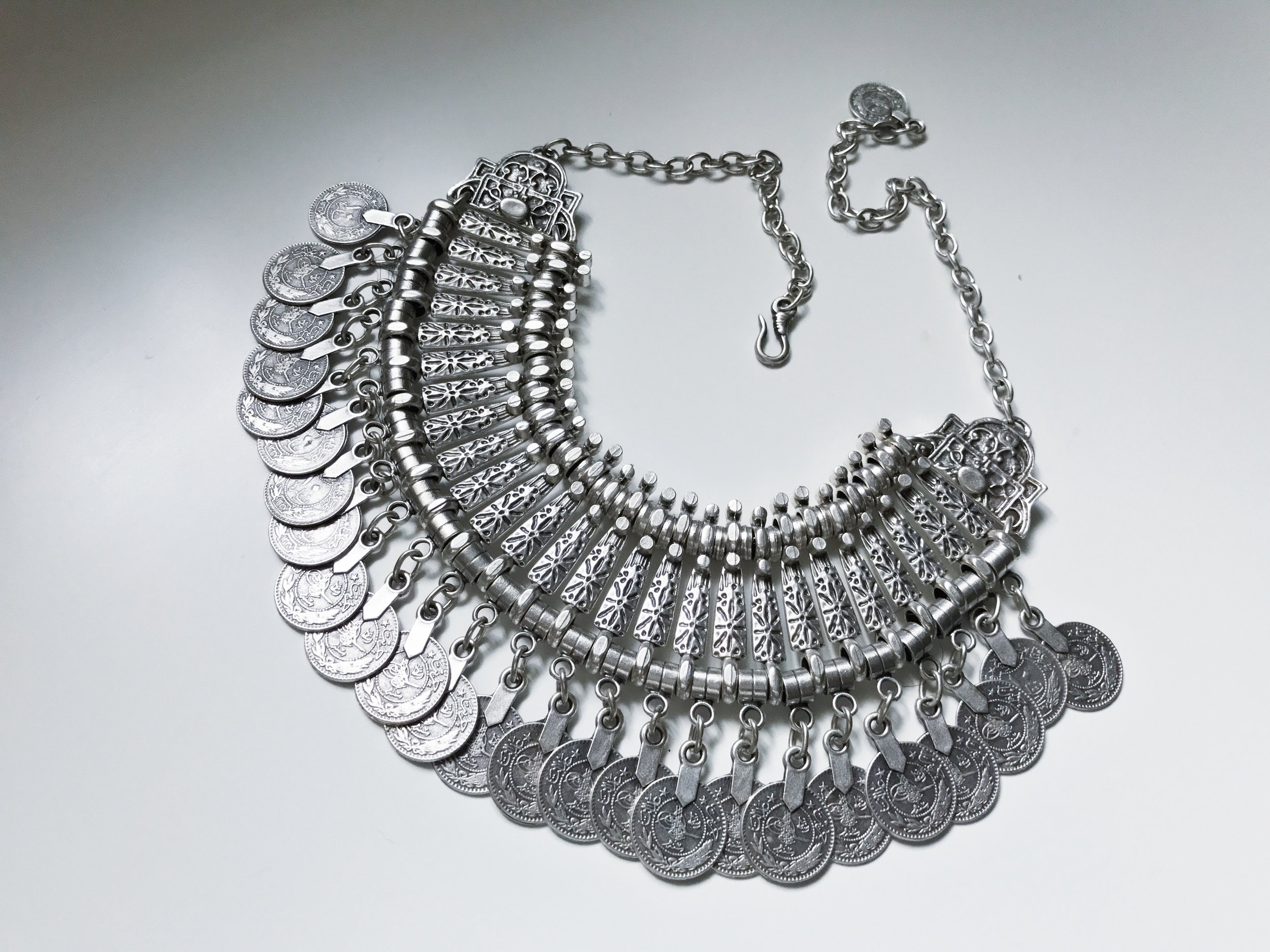 feather and arrow coin statement necklace