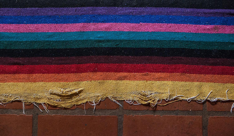pavones-costa-rica-wander-south-colorful-rug.jpg