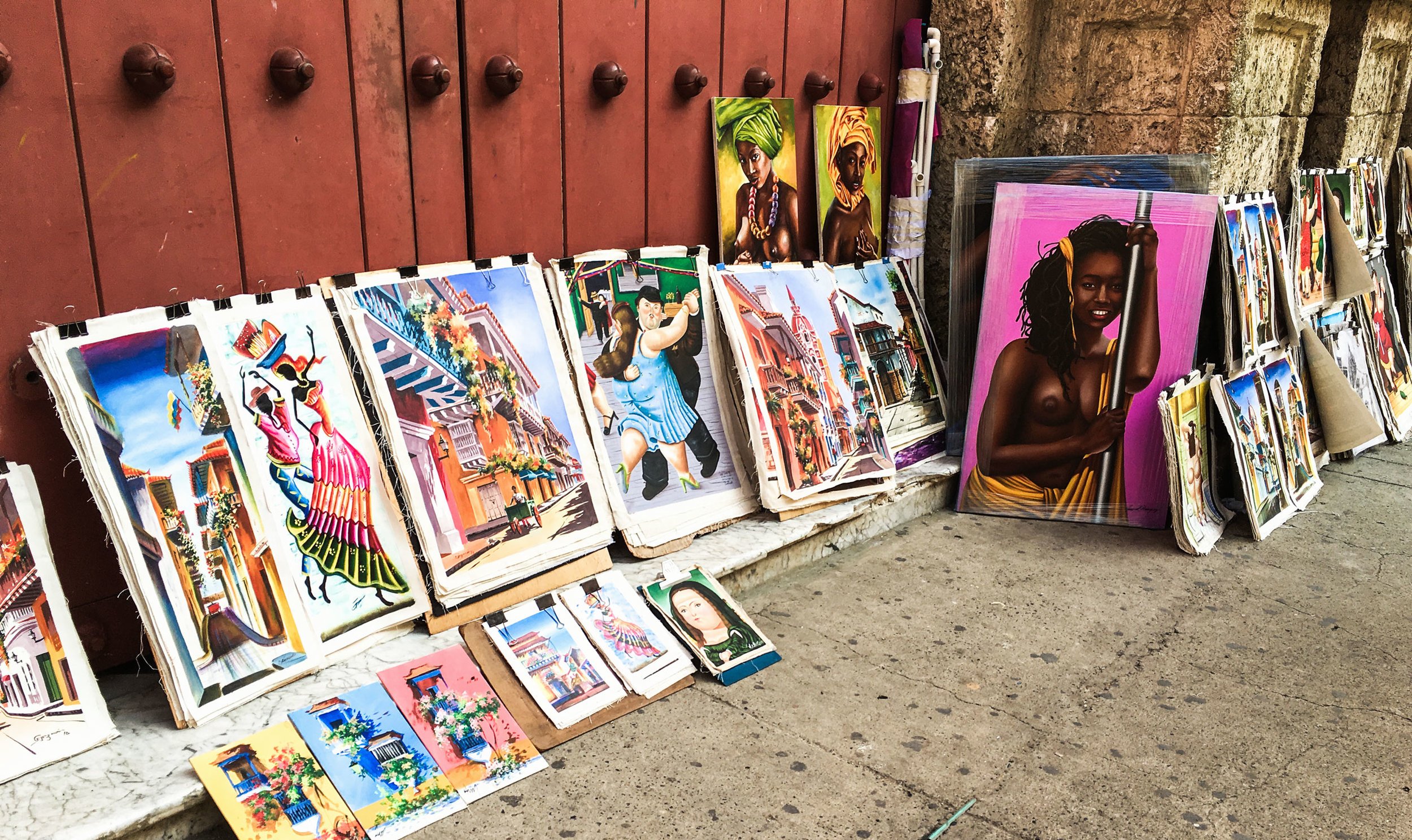 cartagena-colombia-wander-south-old-town-street-vendor-art.jpg