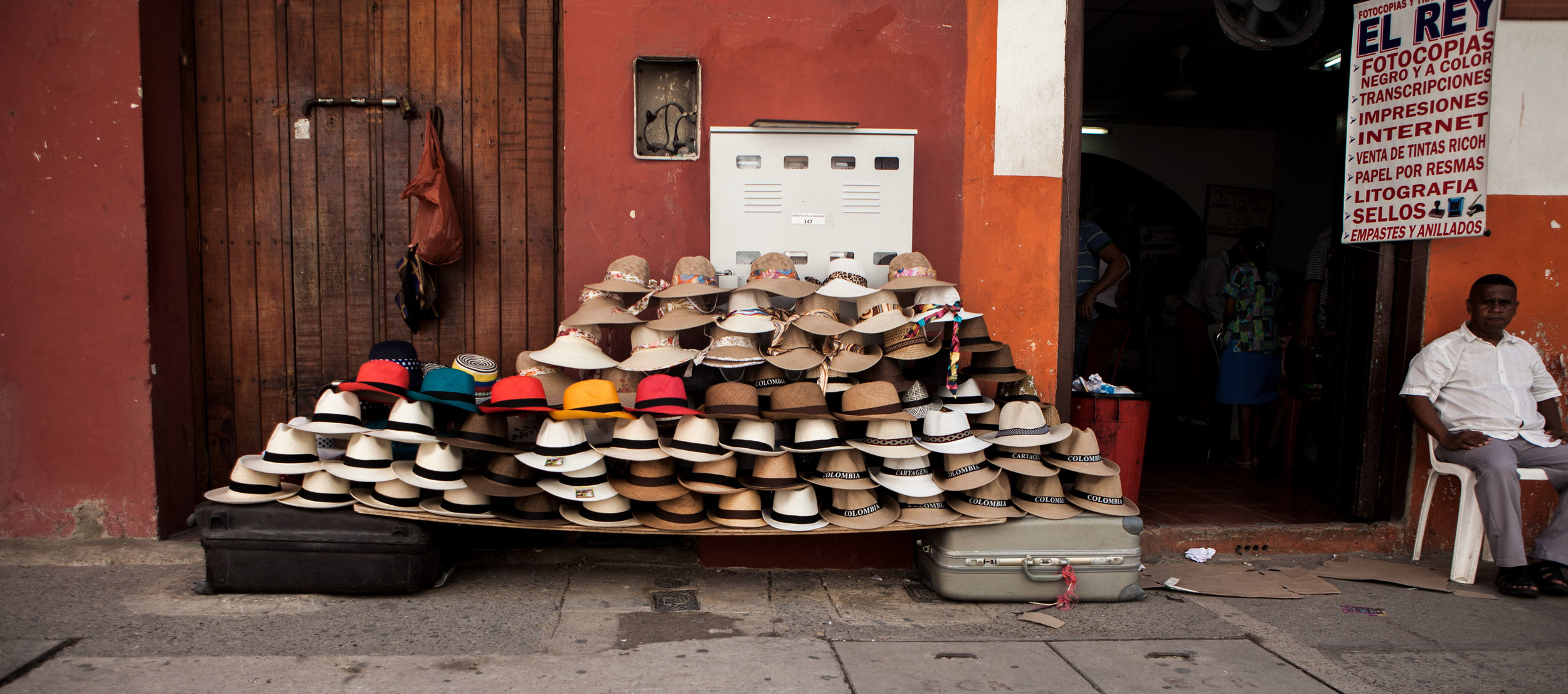 cartagena-colombia-wander-south-old-town-street-vendor-king-of-the-hats.jpg