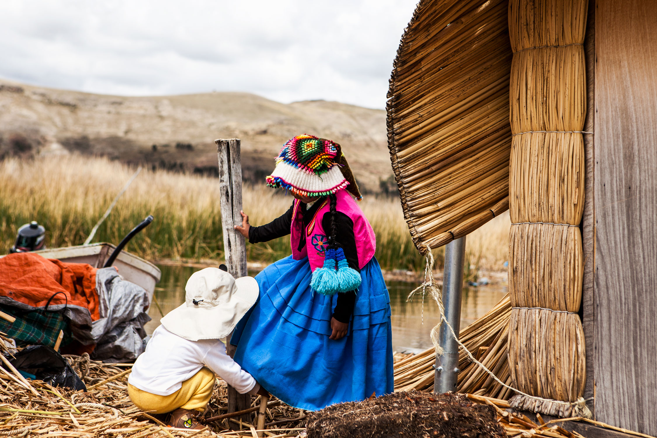 lake-titicaca-puno-peru-wander-south-reed-islands-children-playing.jpg