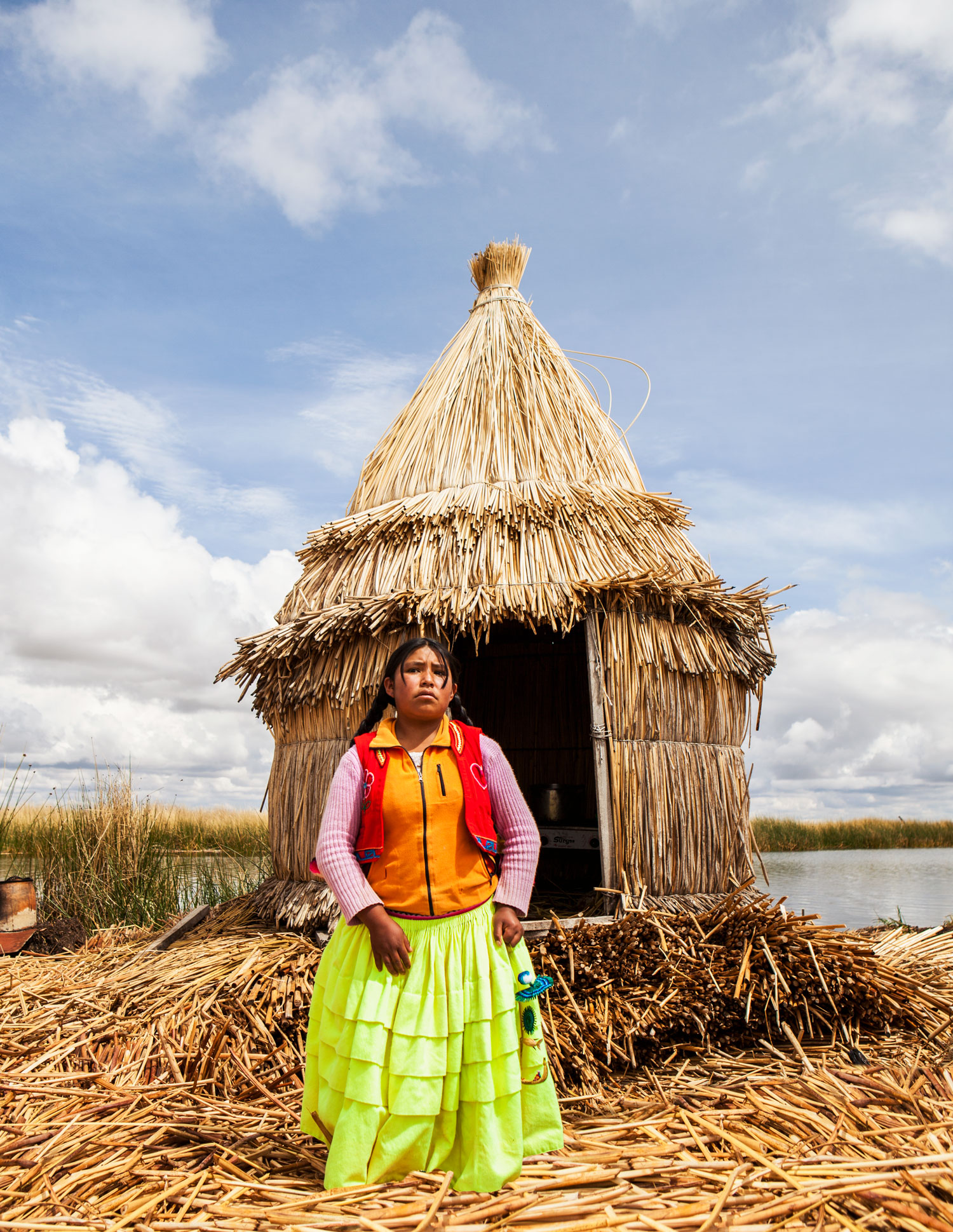 lake-titicaca-puno-peru-wander-south-reed-islands-girl.jpg