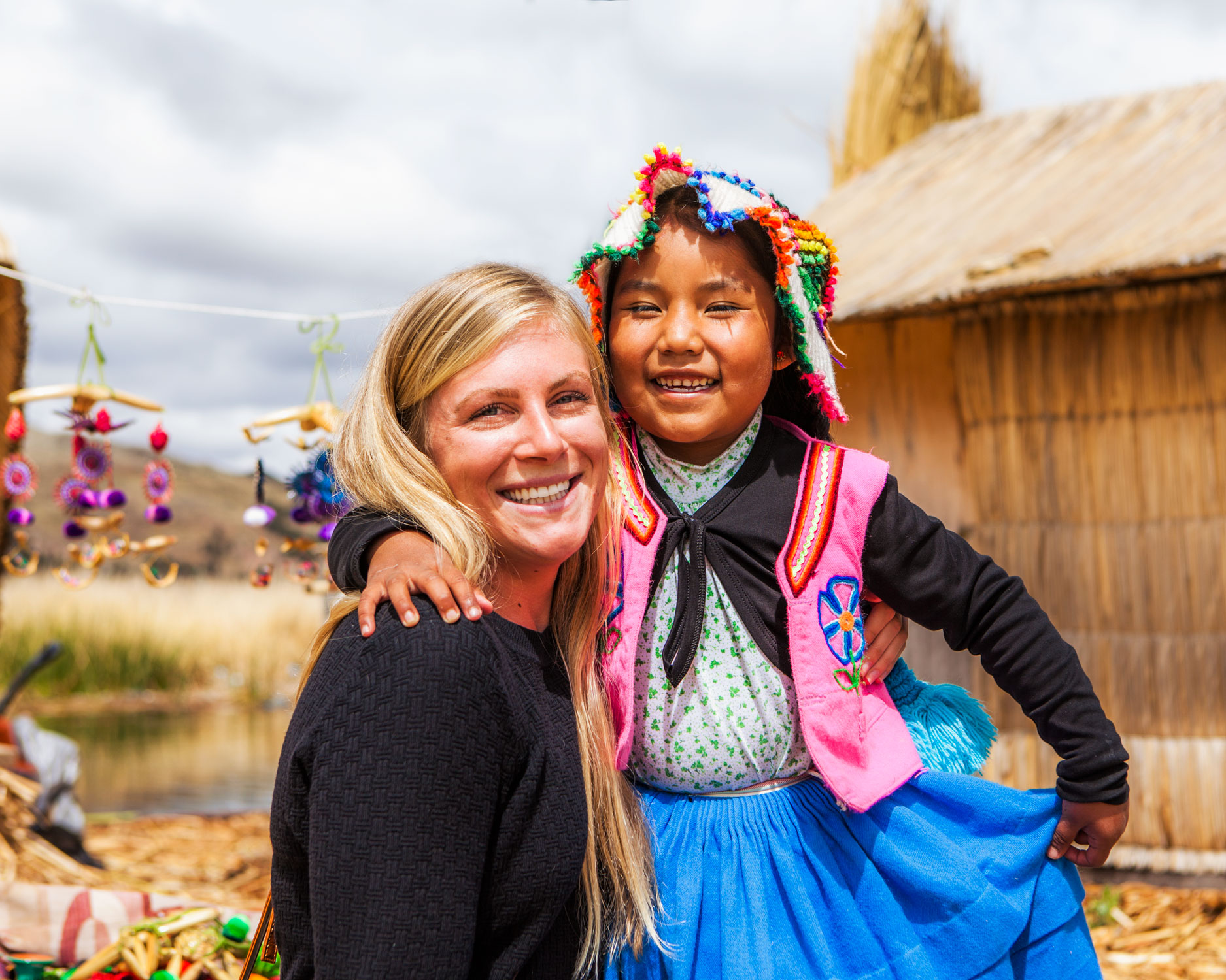 lake-titicaca-puno-peru-wander-south-reed-islands-meg-and-girl.jpg