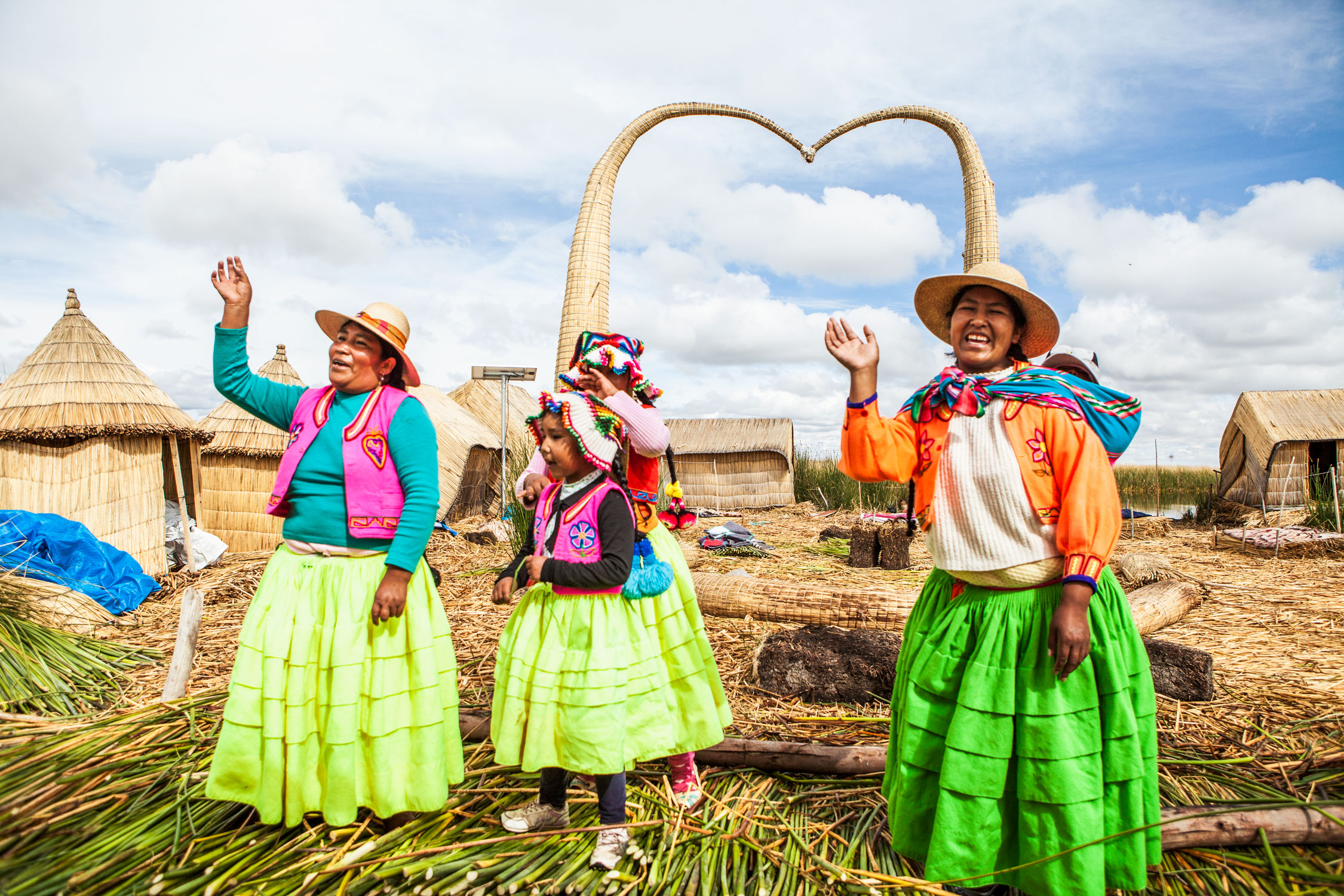 lake-titicaca-puno-peru-wander-south-reed-islands-women.jpg