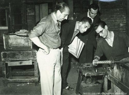 Prof. Flavio Poli (second left, holding sketches) at the ASV Barovier Seguso & Ferro workshop c.1935