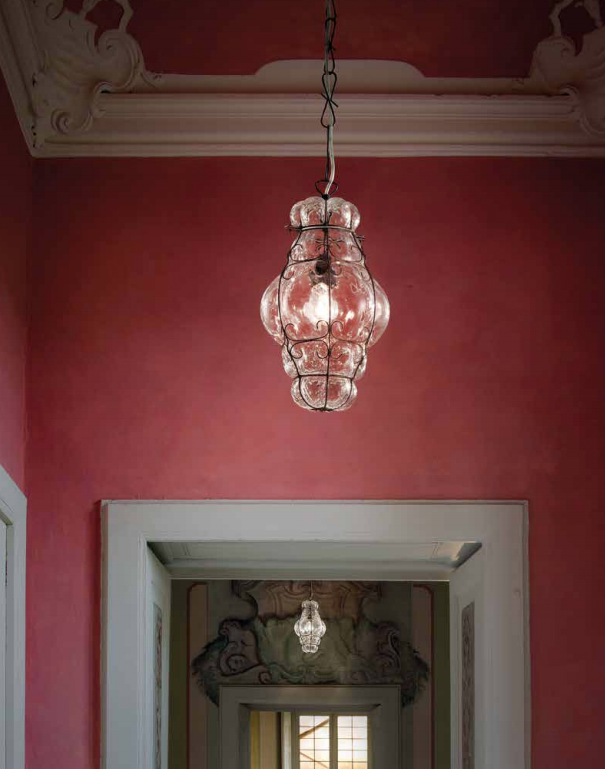Venetian lamps in a wide hallway in Venice. The perfect setting for glass lanterns.
