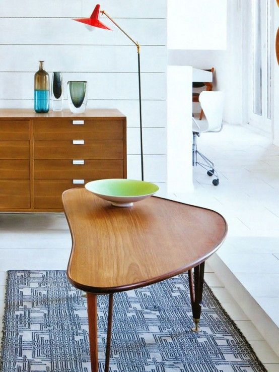 A floor lamp providing focal lighting to objects and punctuation to the end of the cabinet, but open to the room. The lamp itself is on full display in this position. Image courtesy iheartponyup.com