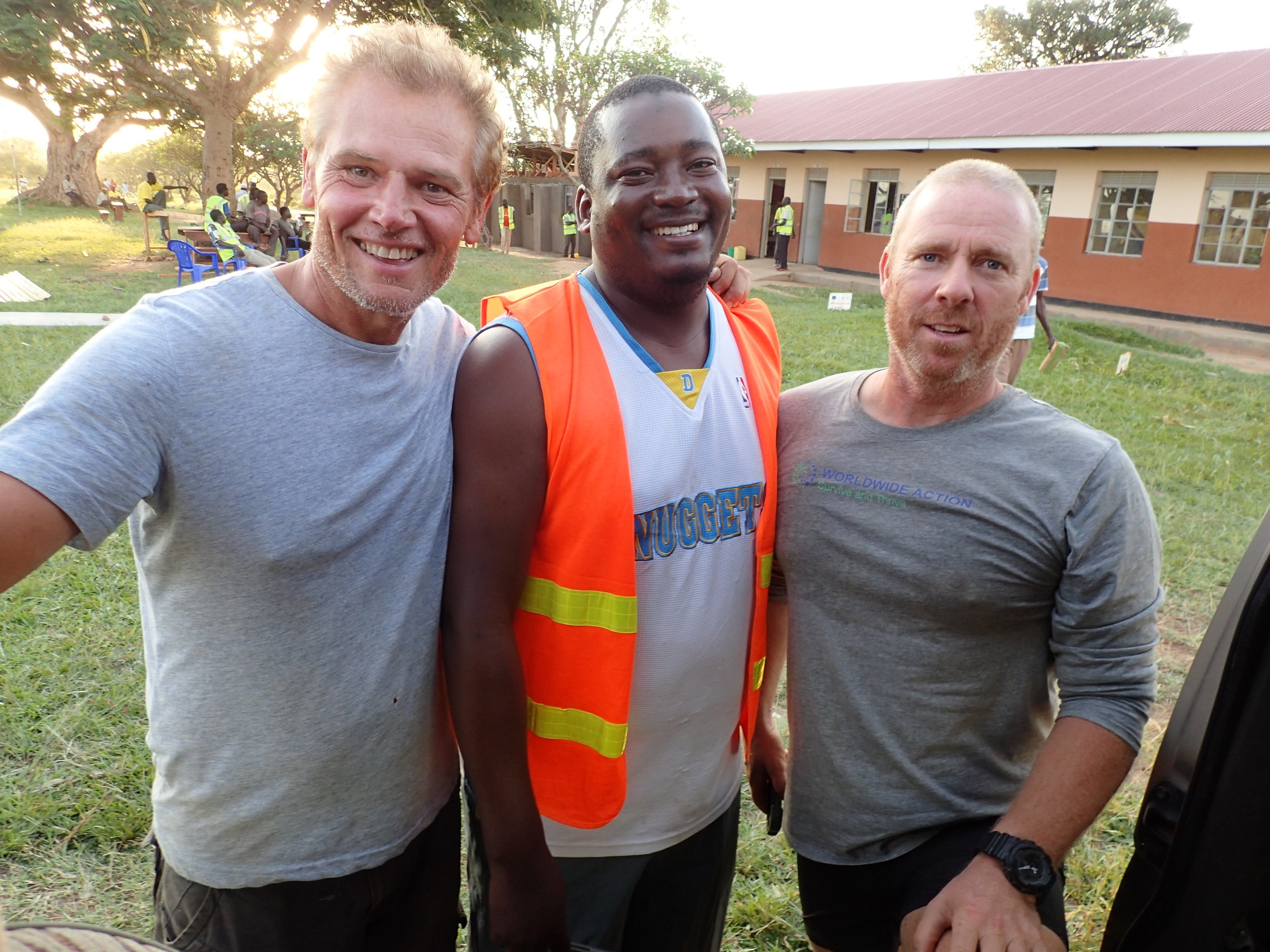 Simon and Graeme with one of the construction workers in Uganda