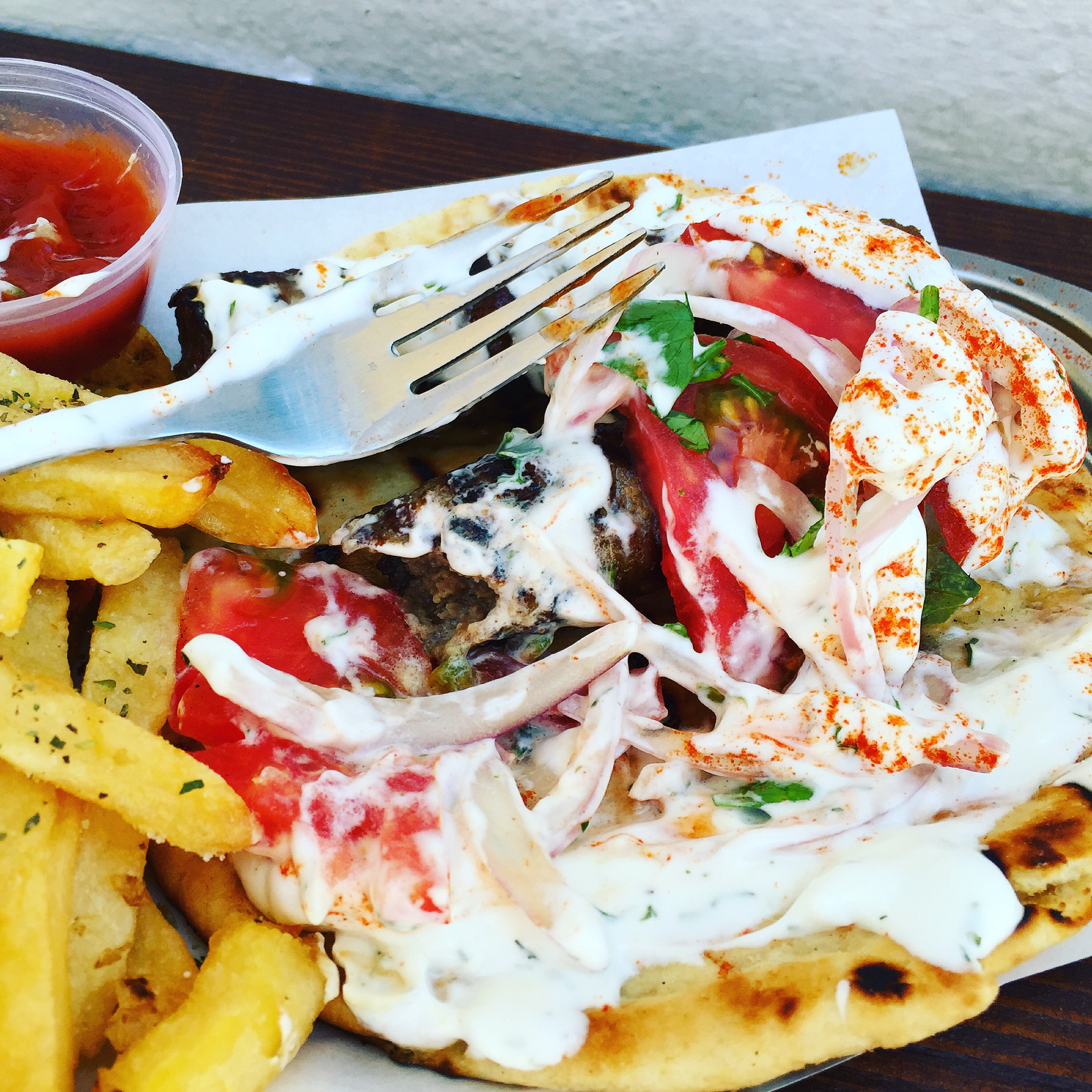 Messy beautiful kebab platter at Pitogyro...hands down best street food in Santorini