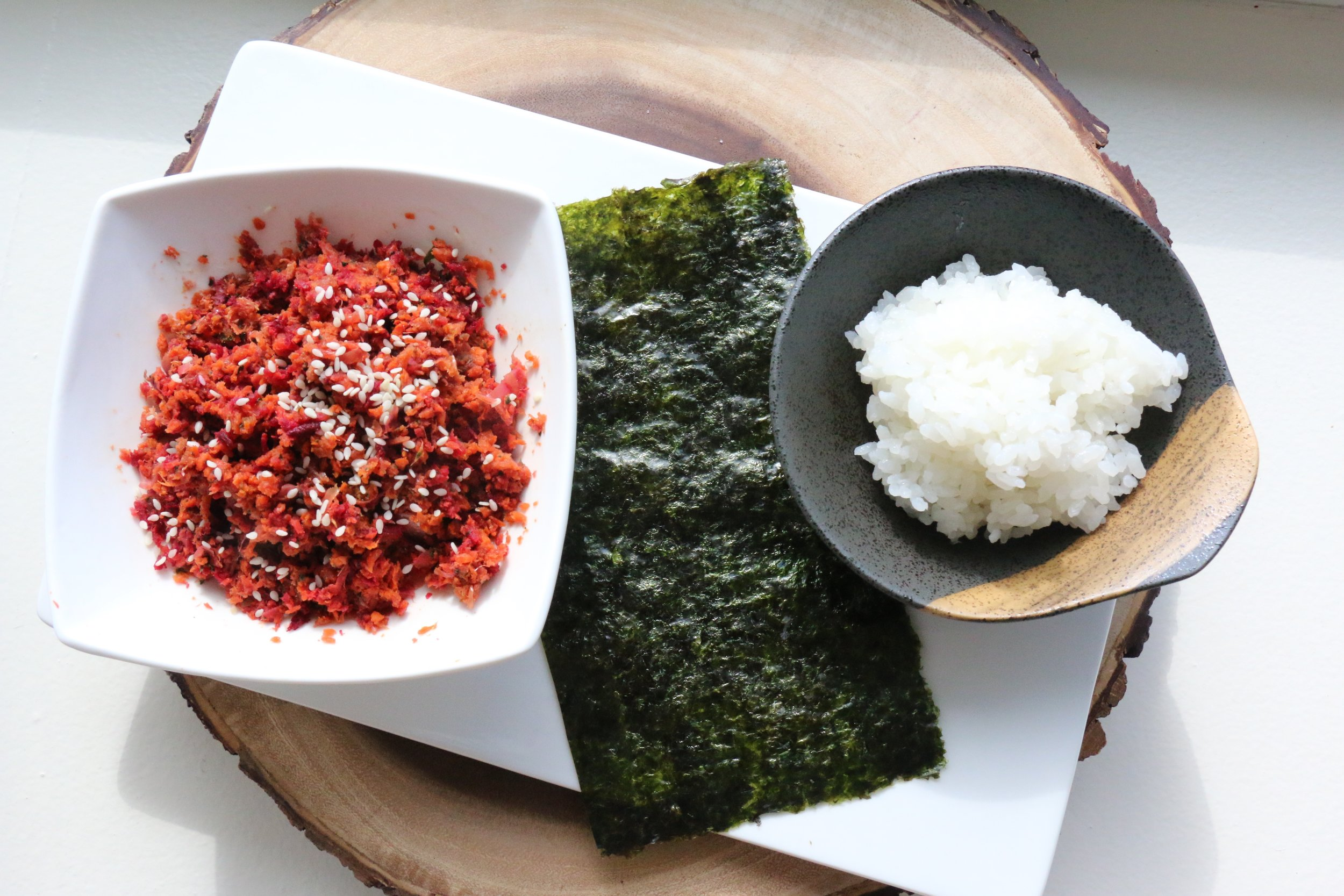 Everything you need to make these rolls: cooked and seasoned sushi rice, beet pulp mixture, and toasted nori