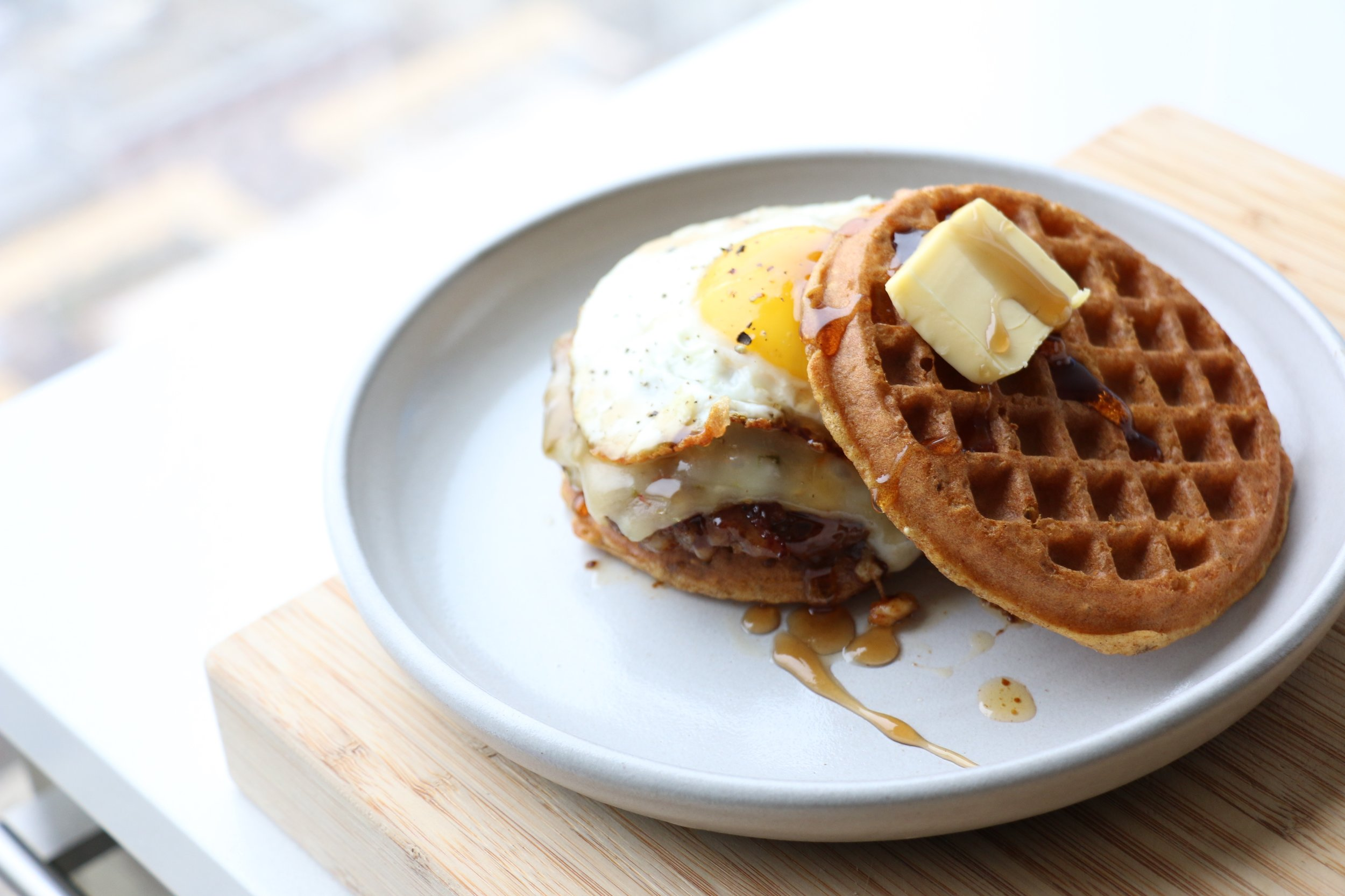 Top it off with the waffle, a slice of warm butter and drizzle some maple syrup on top