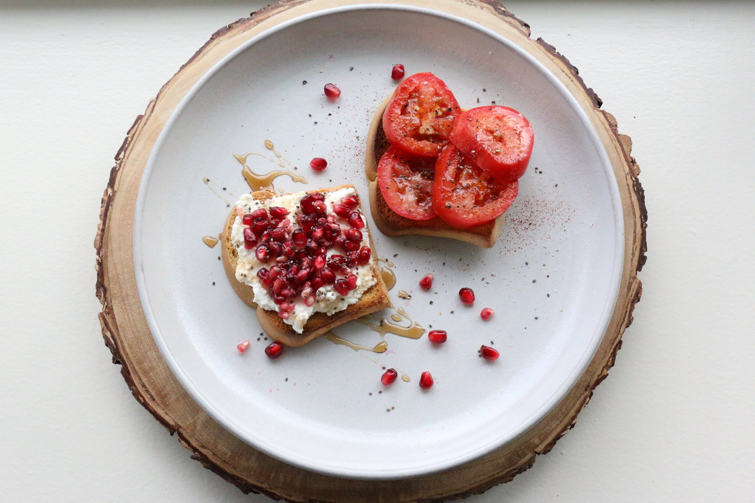 My Brekkie from this morning: Pomegranate Ricotta Toast with Agave & Tomato Olive Oil Toast with Sea Salt