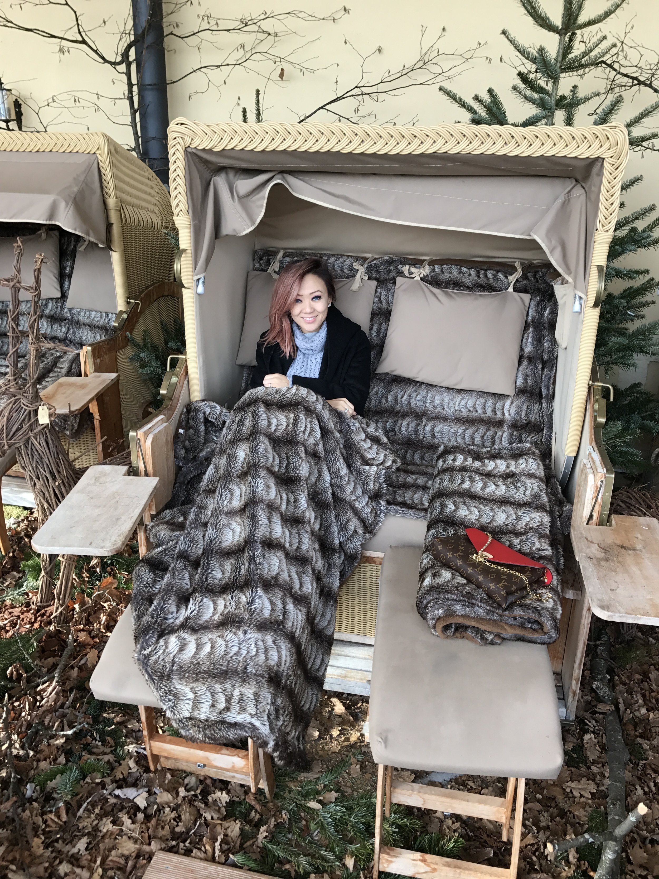 Chilling in their cabana ready to spend a lazy afternoon reading and drinking mulled wine