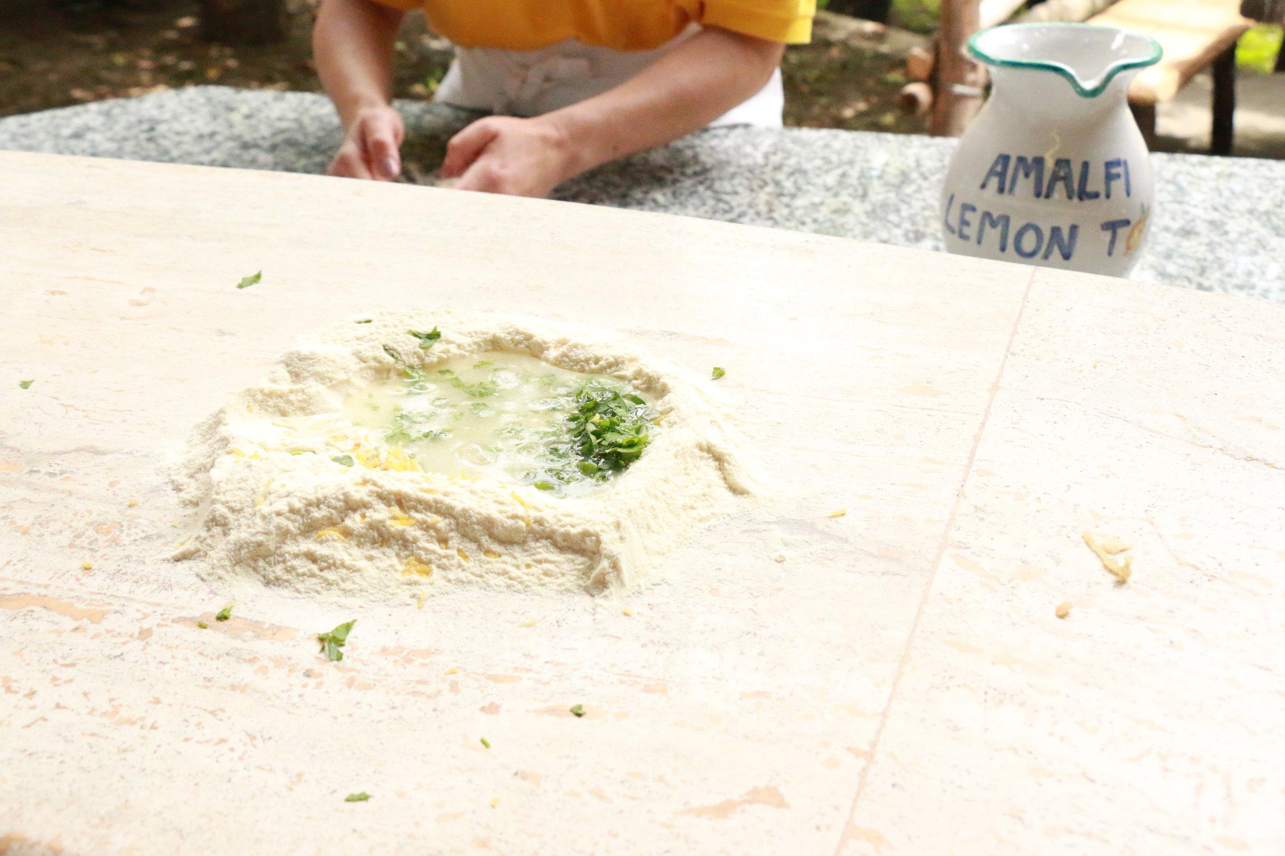 Semolina flour, warm water, fresh chopped herbs, lemon zest, pinch of salt