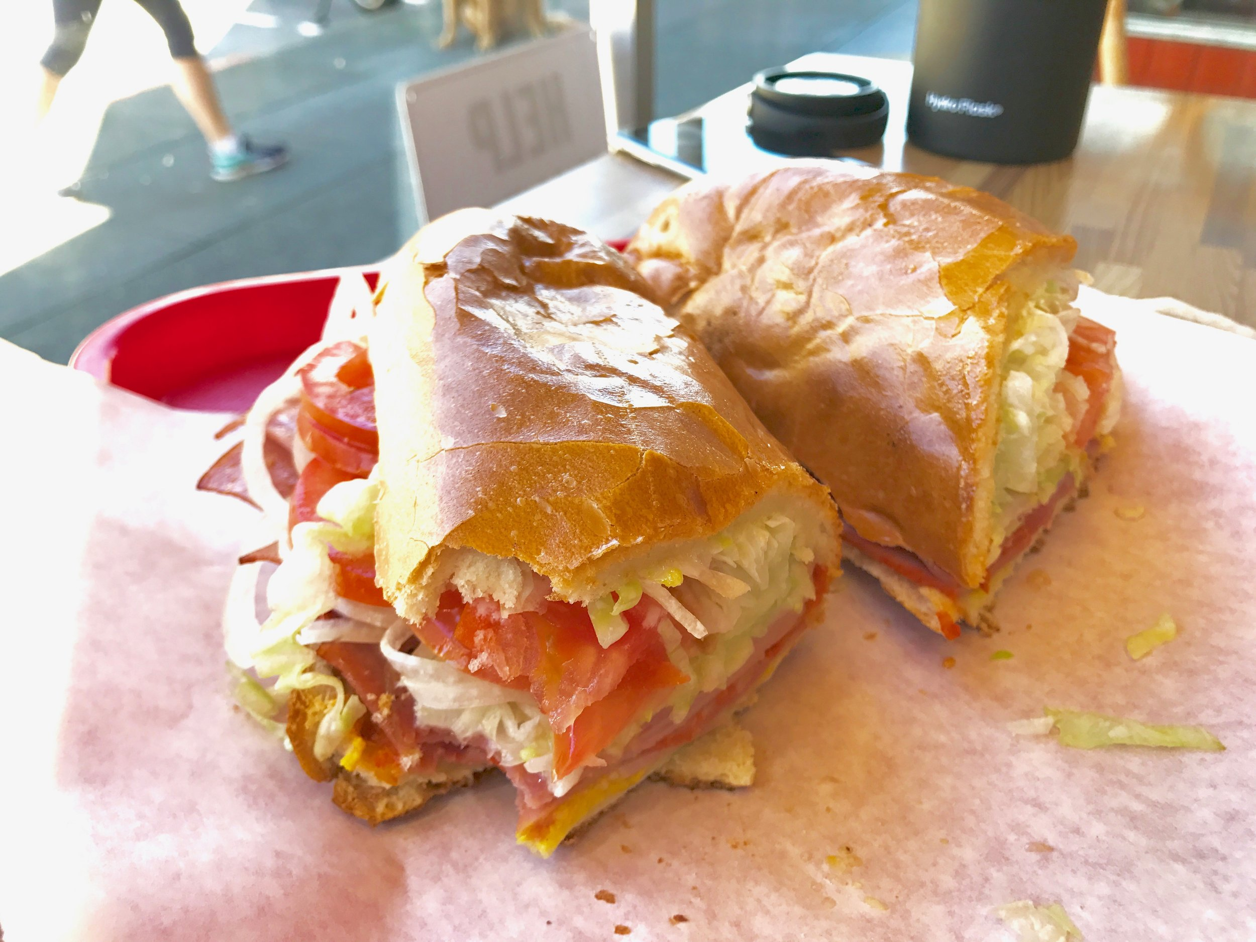 The Italiano:think salami, turkey, mortadella, thinly sliced onions, tomatoes, lettuce, mayo, lettuce, secret sauce all inside a perfectly toasted bread with melted cheese