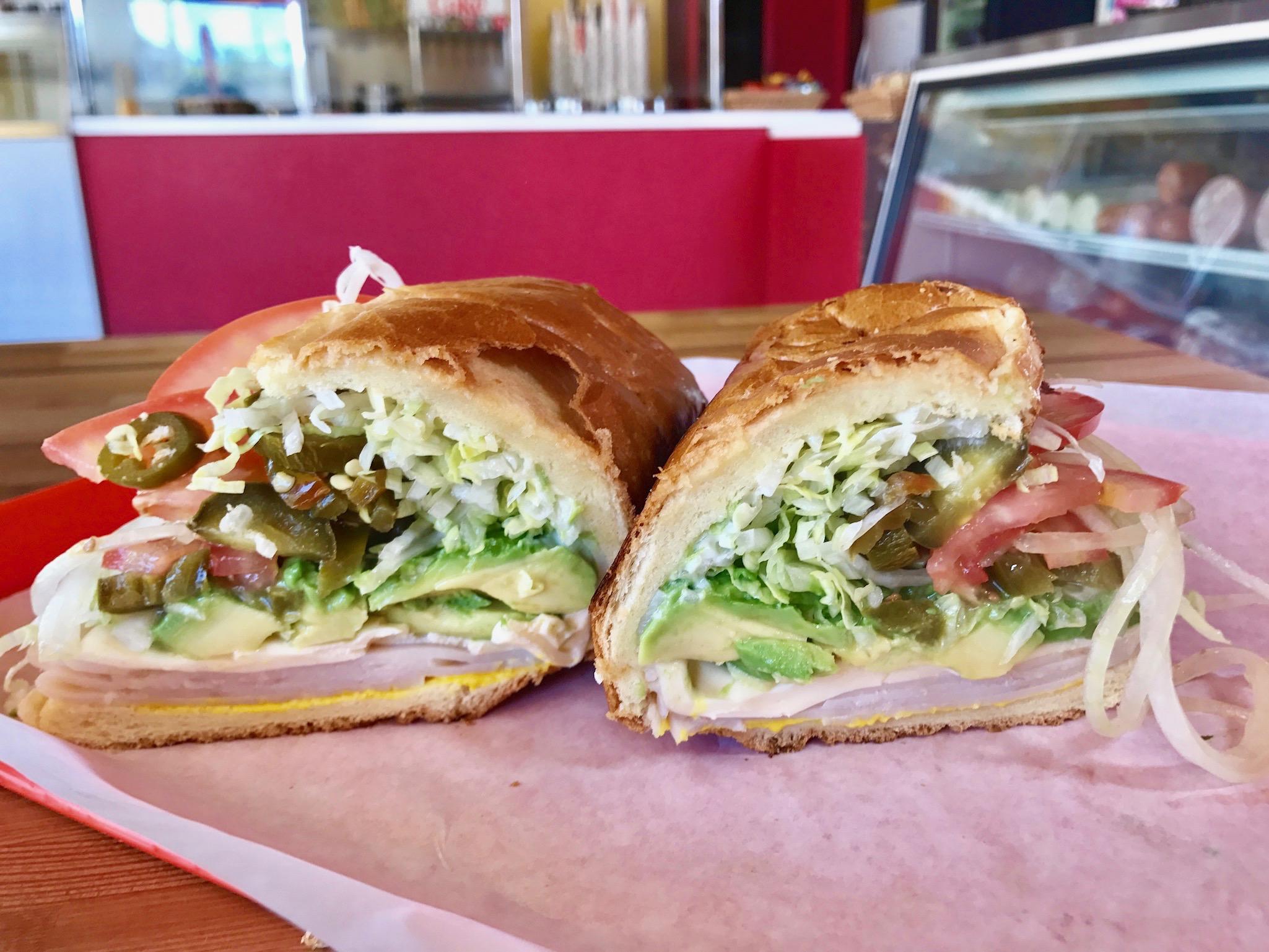 The avocado turkey sandwich will added jalapeno.