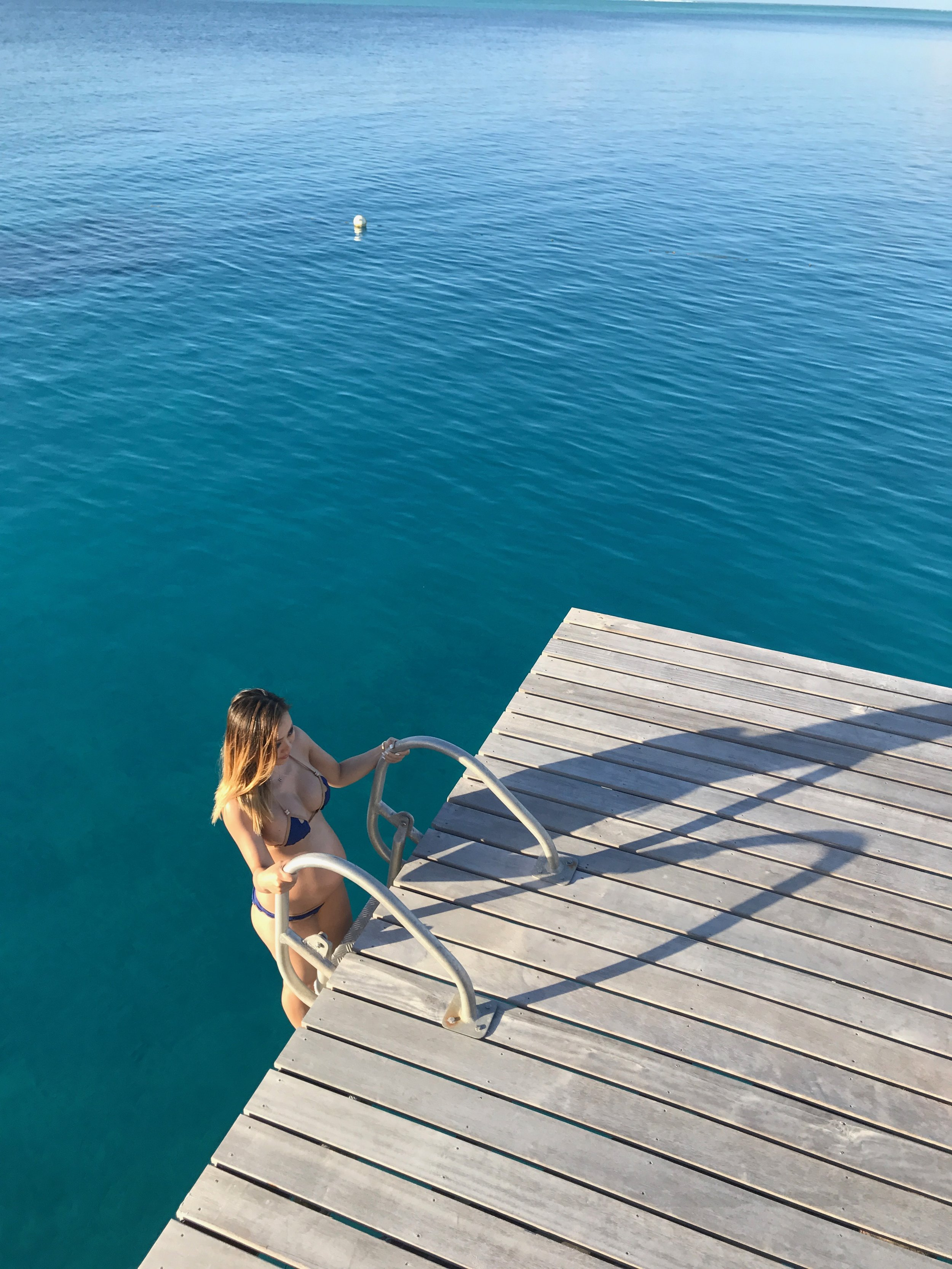 Or take a dip right off your own villa deck into the clear waters for a morning swim