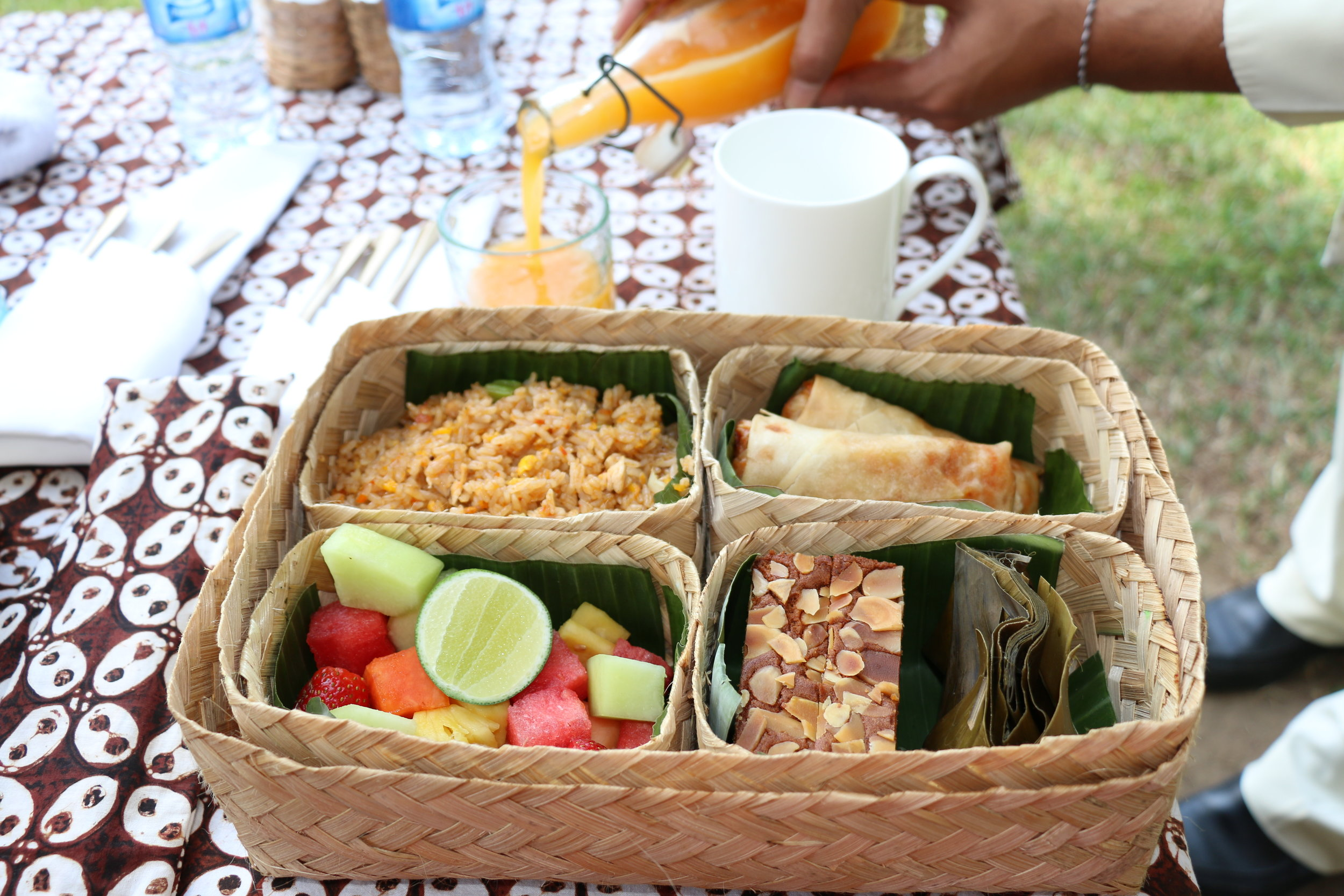 Indonesian Breakfast Set, which I selected as my choice,  comes with coffee, fresh mango orange juice, nasi goreng (fried rice), springrolls, fresh cut fruit, traditional pastries (some kind of cake with almonds and banana leaf wrapped sticky rice dumpling)